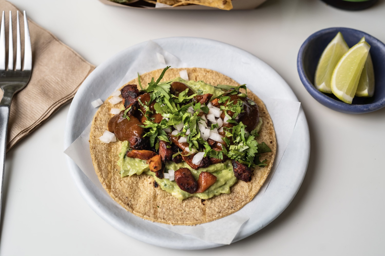 Plant-based carne asada taco at Taco Vega on a white plate.