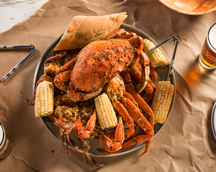 One pound of snow crab legs, one Dungeness crab, three hard shell crabs and corn