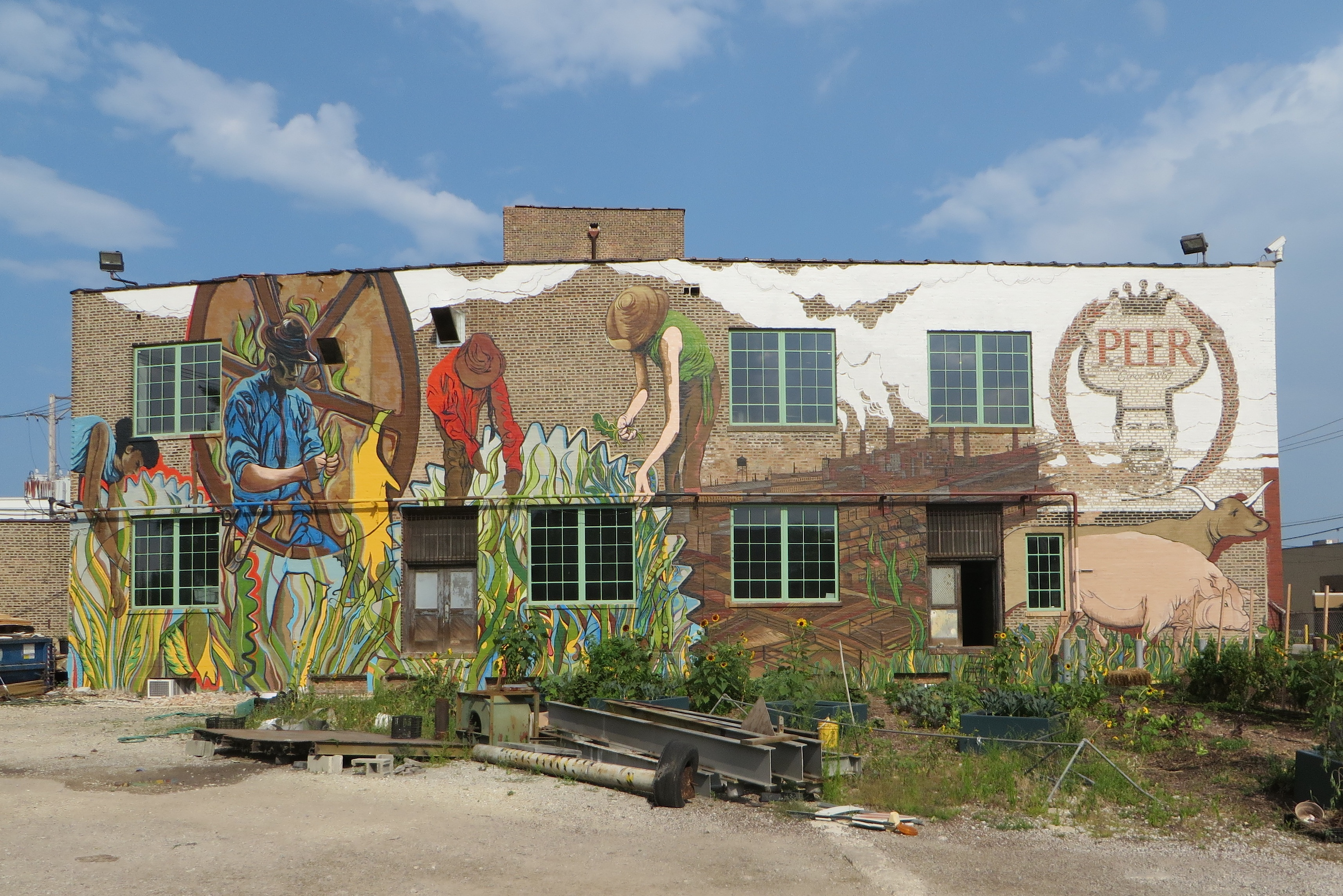 Joe Miller painted this mural in 2014 on a building at 1400 W. 46th St. that anchors an urban farm and food incubator called The Plant, an old meatpacking building back when the Chicago's stockyards were still around.