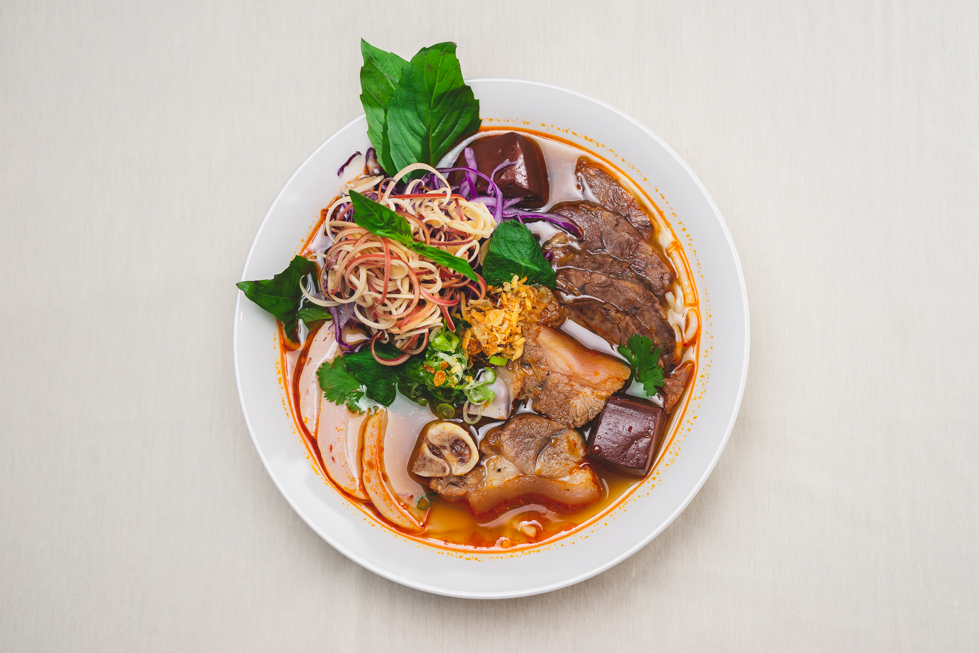 Overhead view of a bowl of bun bo Hue