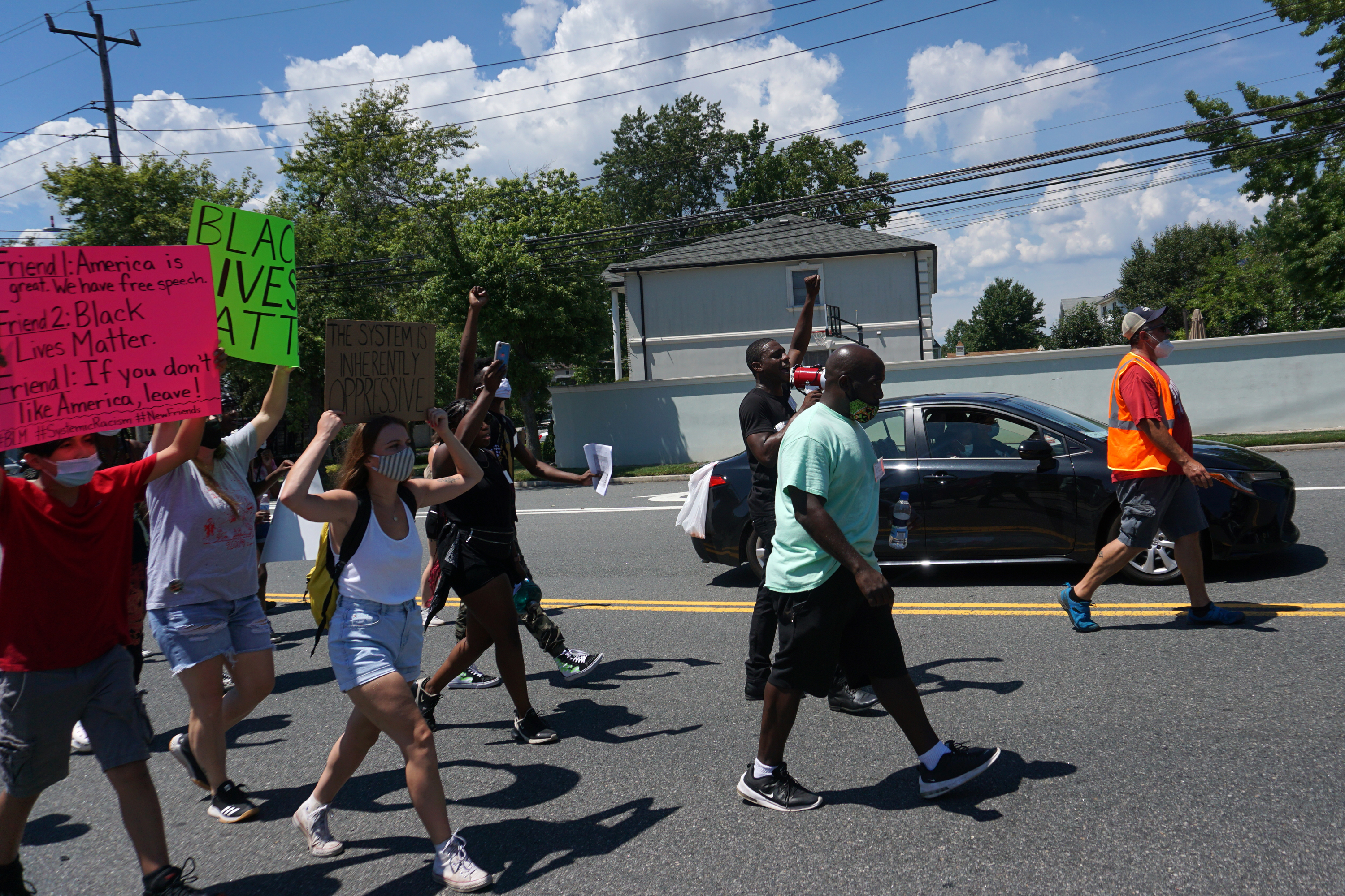 The Young Leaders of Staten Island lead a march across the borough from Sandy Ground, the first free black community in New York, Aug. 1, 2020.