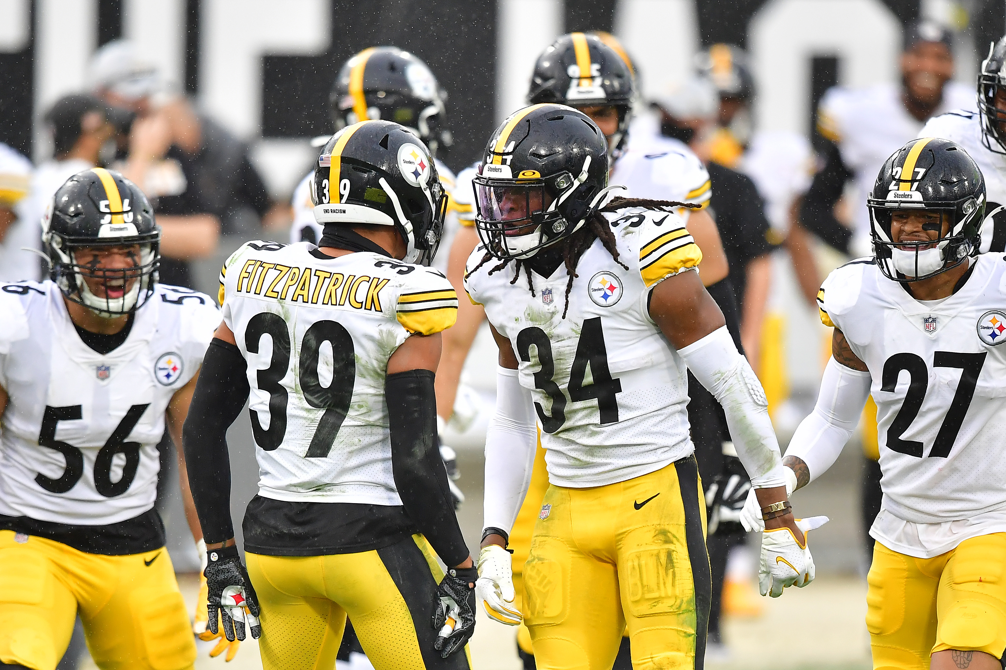 Minkah Fitzpatrick #39 celebratews with Terrell Edmunds #34 of the Pittsburgh Steelers after Edmunds' interception during the second half against the Jacksonville Jaguars at TIAA Bank Field on November 22, 2020 in Jacksonville, Florida.
