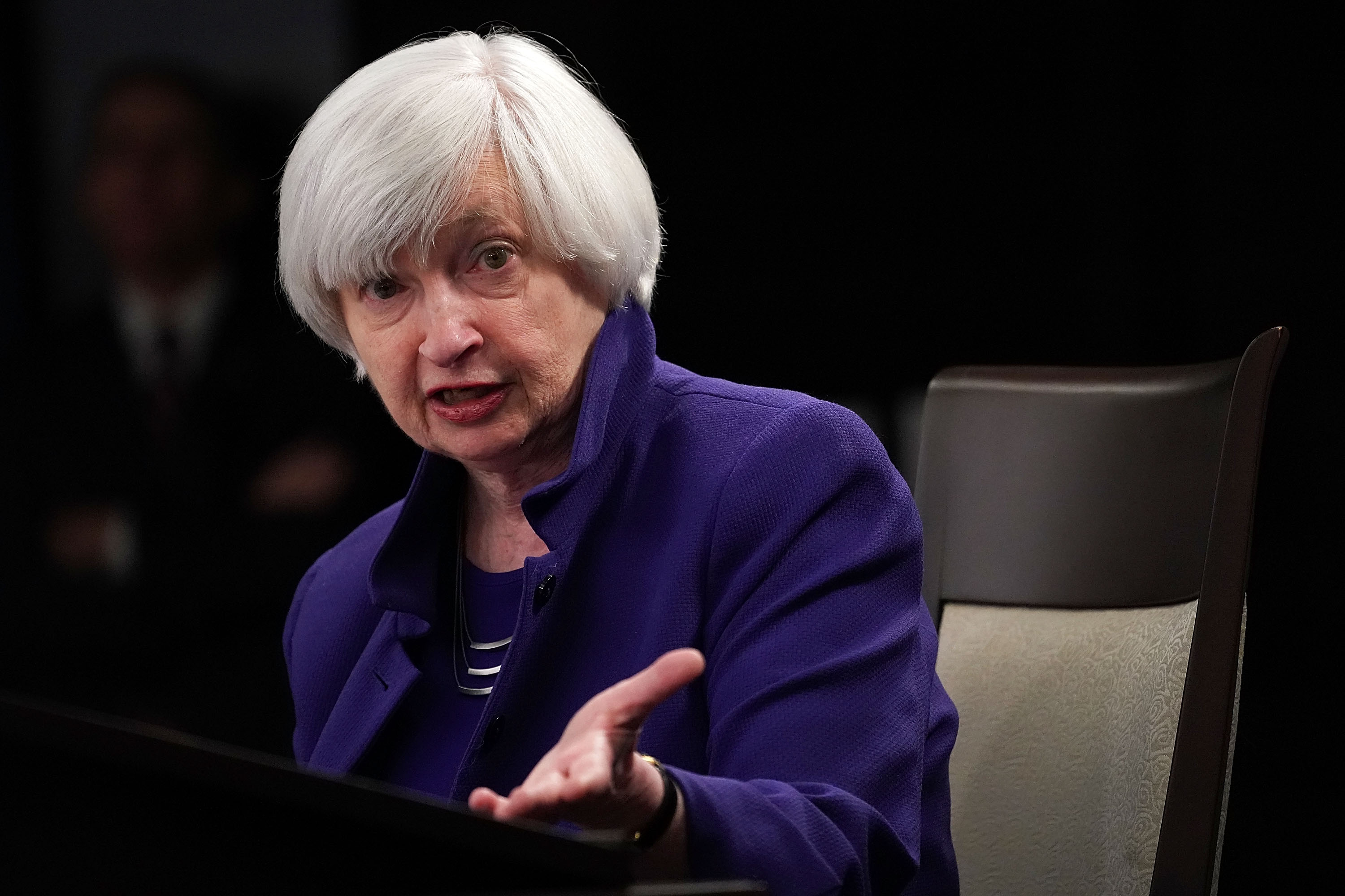 Janet Yellen seated and speaking on a stage.