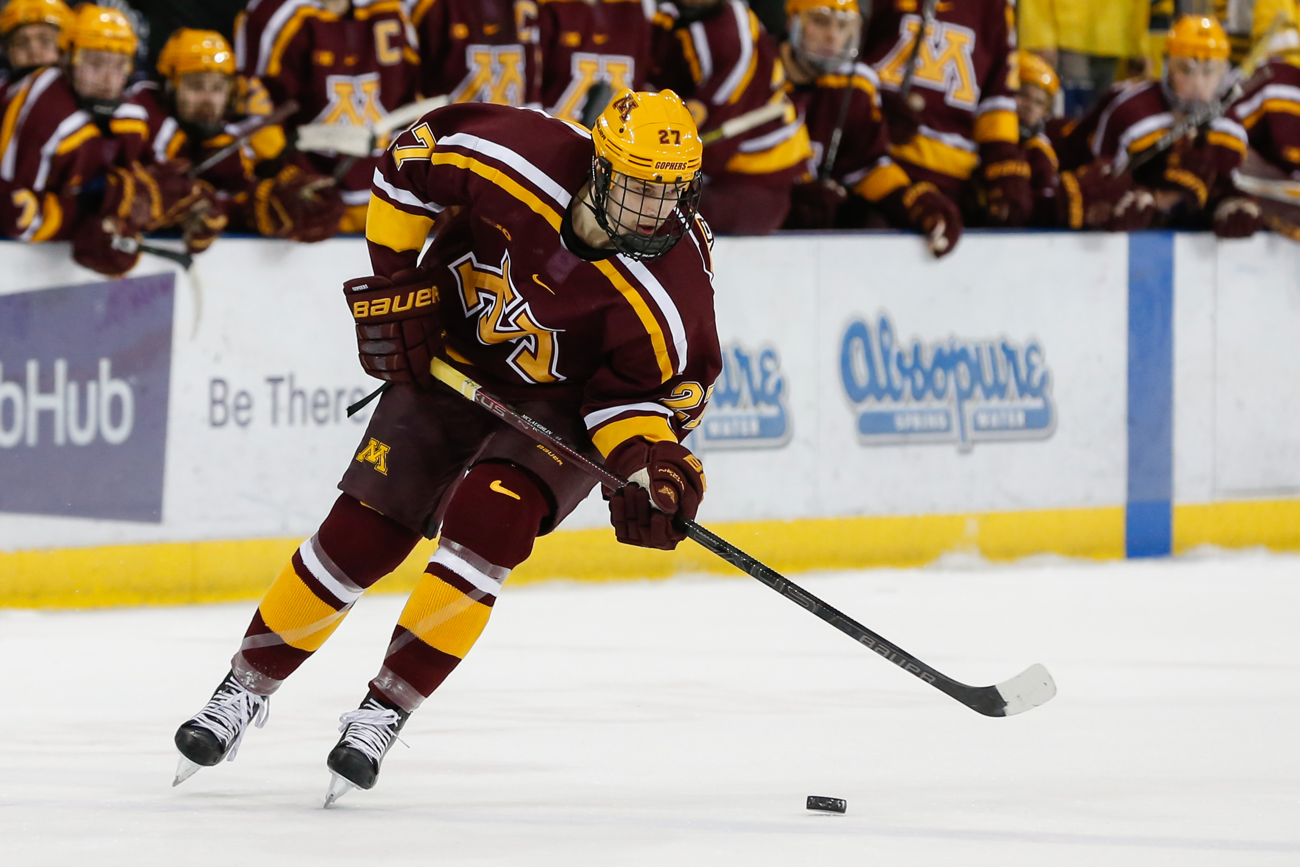 Minnesota Golden Gophers forward Blake McLaughlin (27) skates with the puck during a regular season Big 10 Conference hockey game between the Minnesota Golden Gophers and Michigan Wolverines on December 8, 2018 at Yost Ice Arena in Ann Arbor, Michigan.