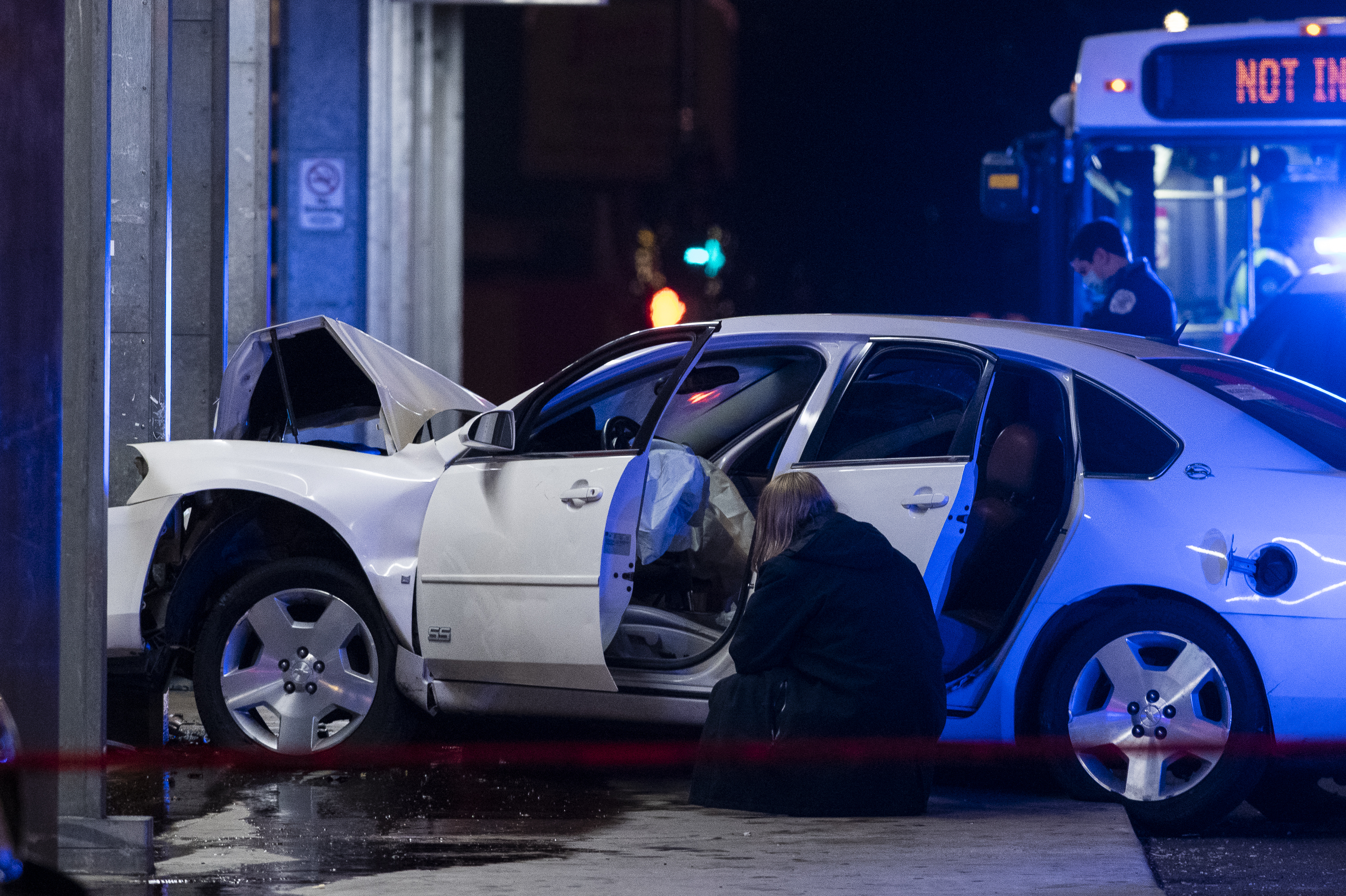 Chicago police investigate the scene where a police officer was dragged by a white Impala at the 95th and Dan Ryan Red Line station Nov. 23, 2020.