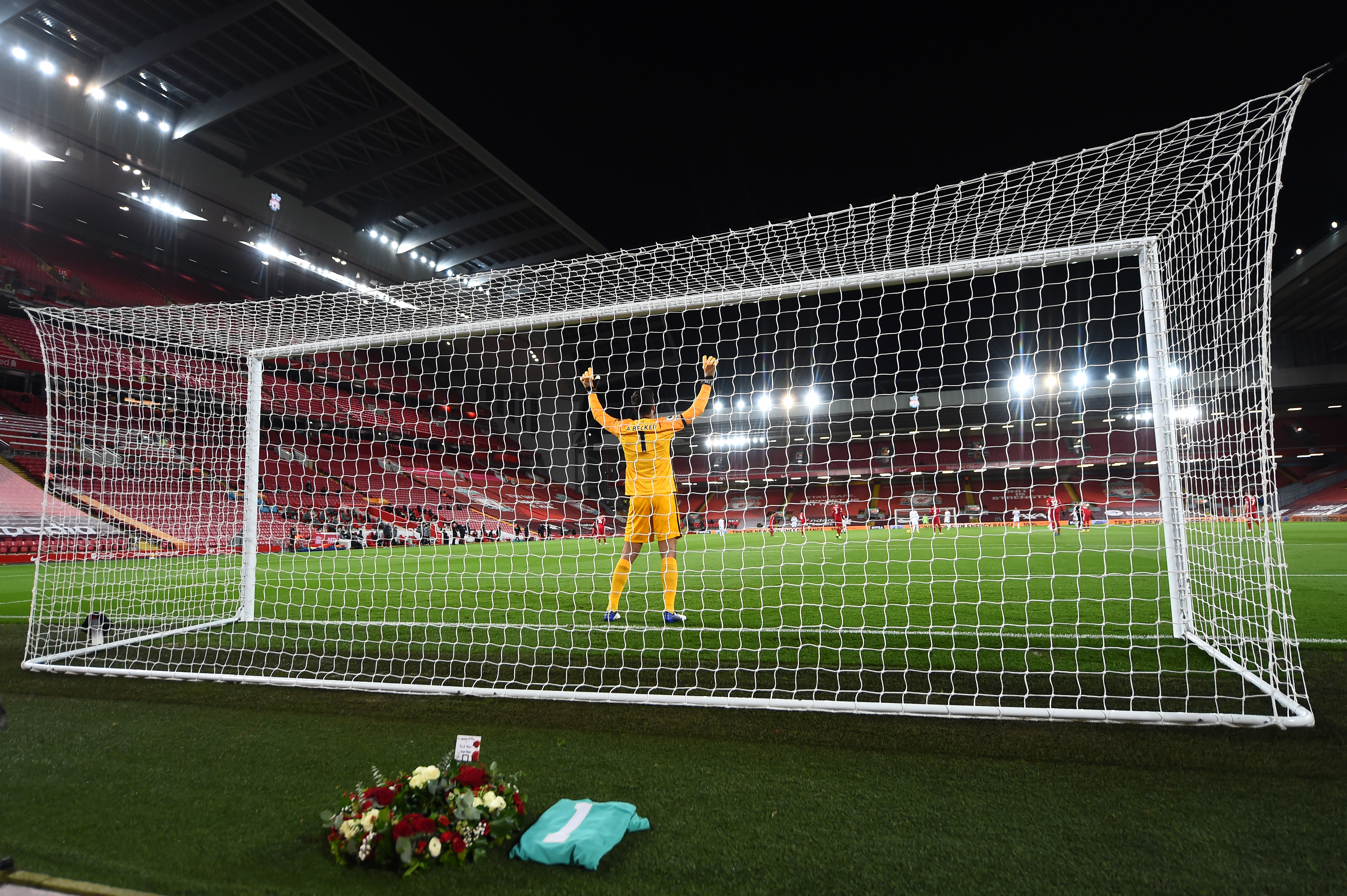 Alisson prays in front of the Ray Clemence wreath - Liverpool - Premier League - Anfield