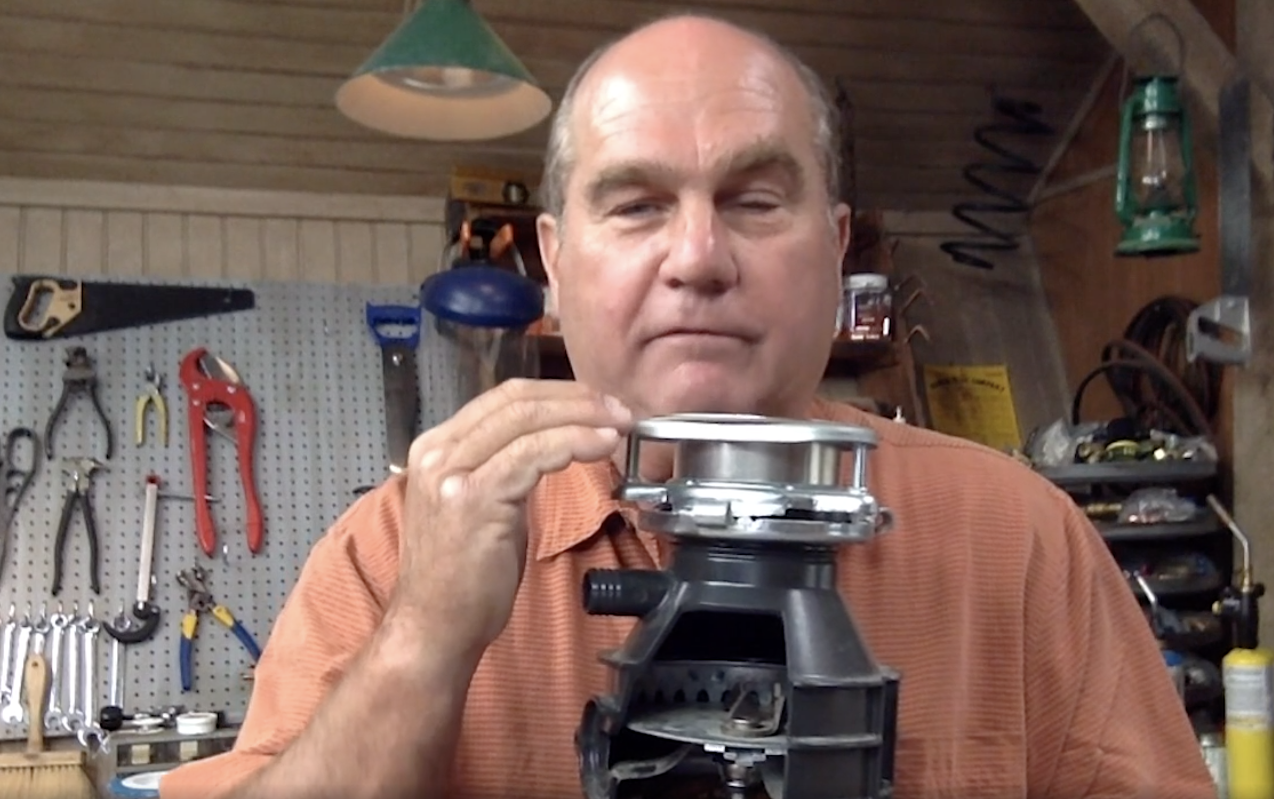 Richard Trethewey shows the inner workings of a garbage disposer.