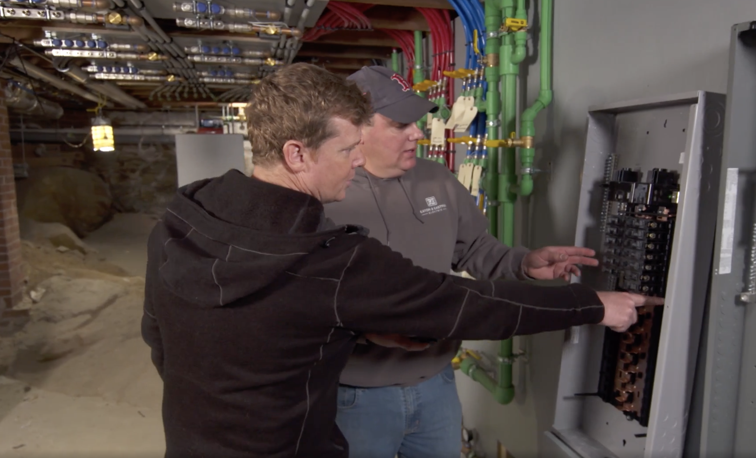 Kevin O'Connor and Heath Eastman review an electrical panel.