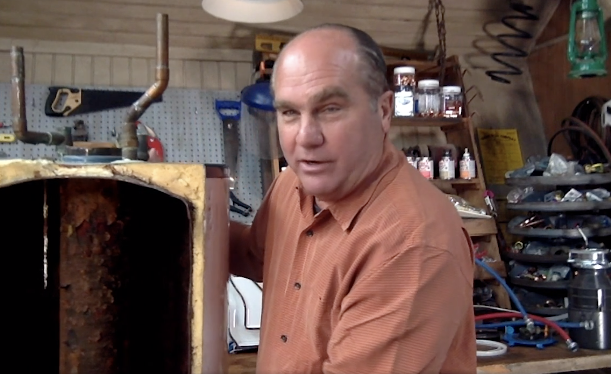 Richard Trethewey shows corrosion inside a water heater.