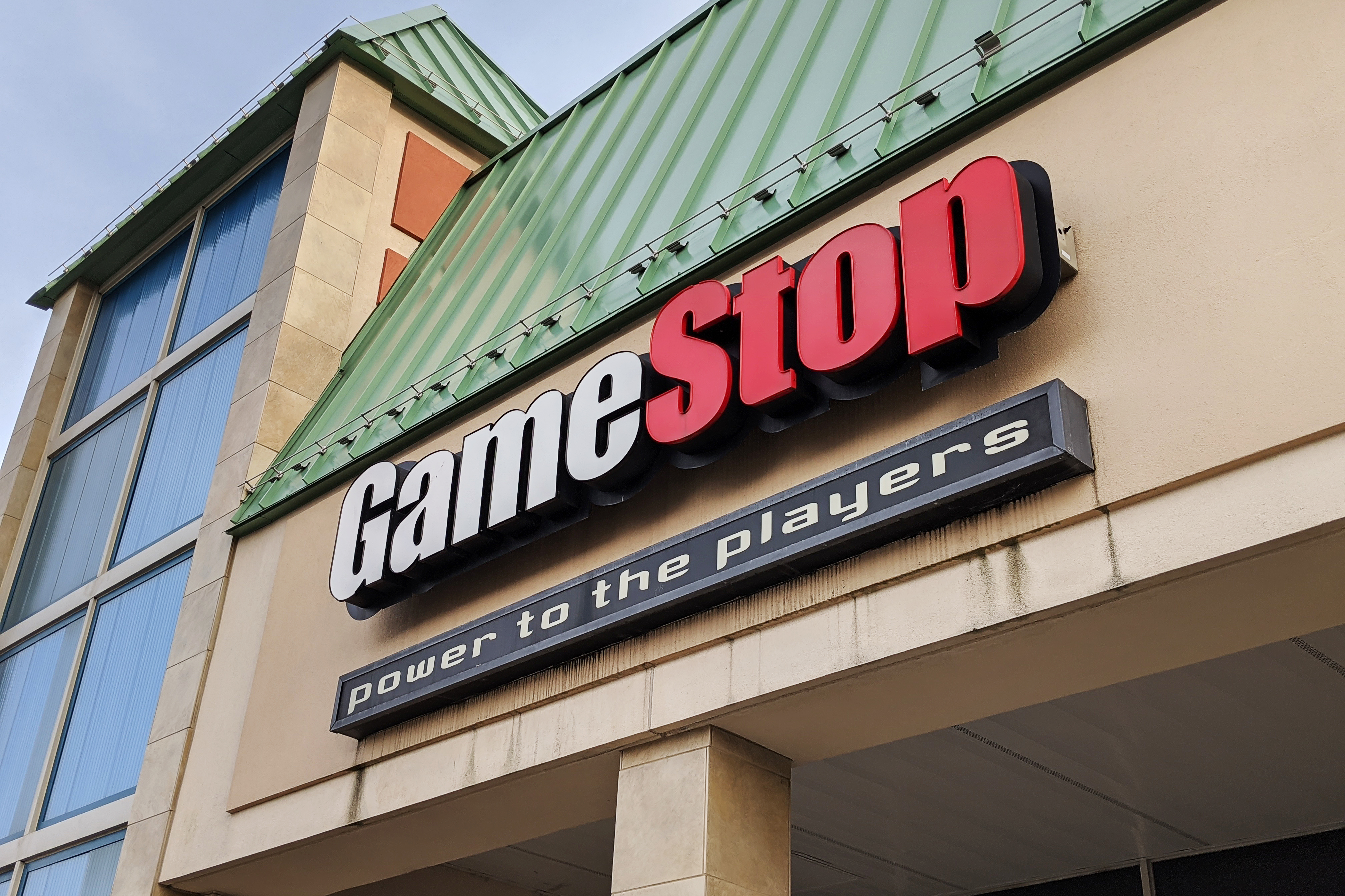 GameStop sign on the front of a strip mall building