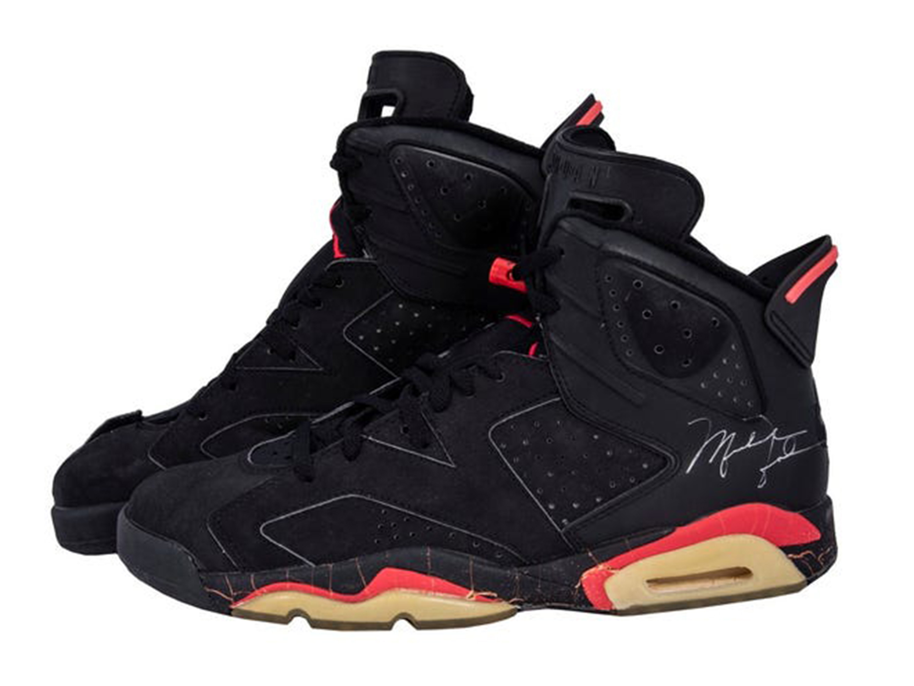 The signed (and cut) pair of Air Jordans that Jordan wore in Game 4 of the 1991 Finals.