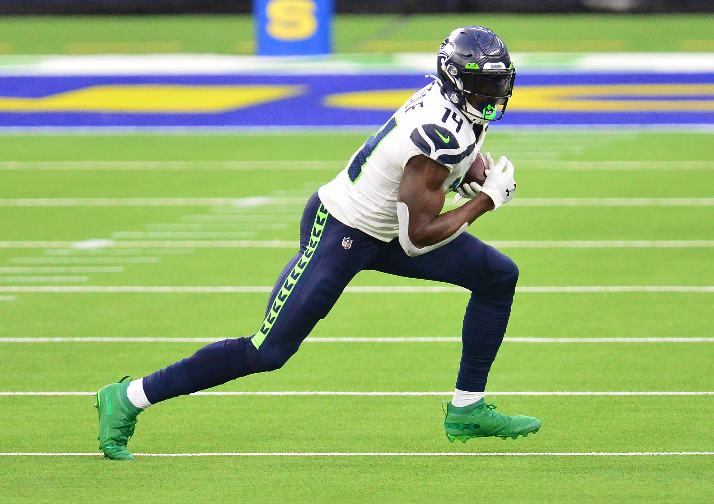 Seattle Seahawks wide receiver DK Metcalf (14) runs the ball against the Los Angeles Rams during the second half at SoFi Stadium.