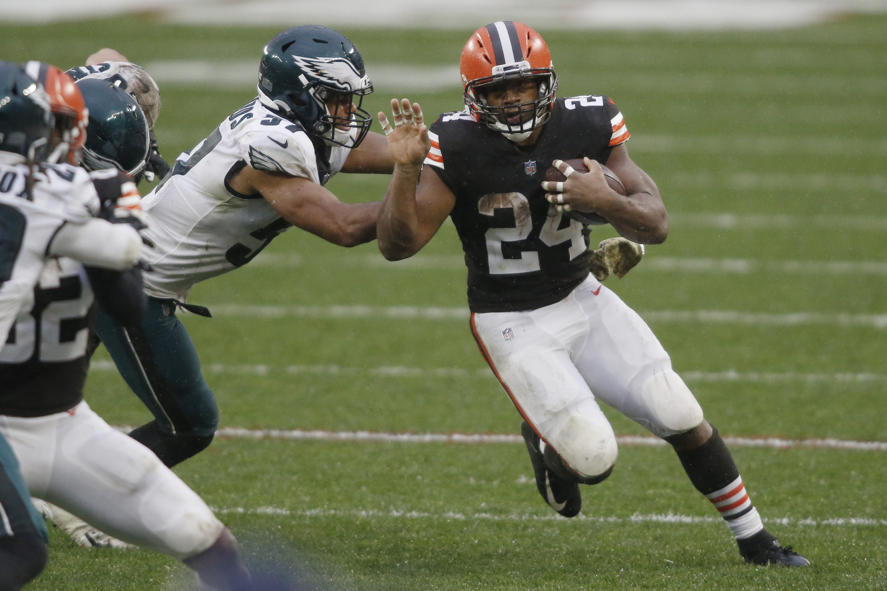 Cleveland Browns running back Nick Chubb (24) runs with the ball as Philadelphia Eagles linebacker T.J. Edwards (57) defends during the second half at FirstEnergy Stadium.