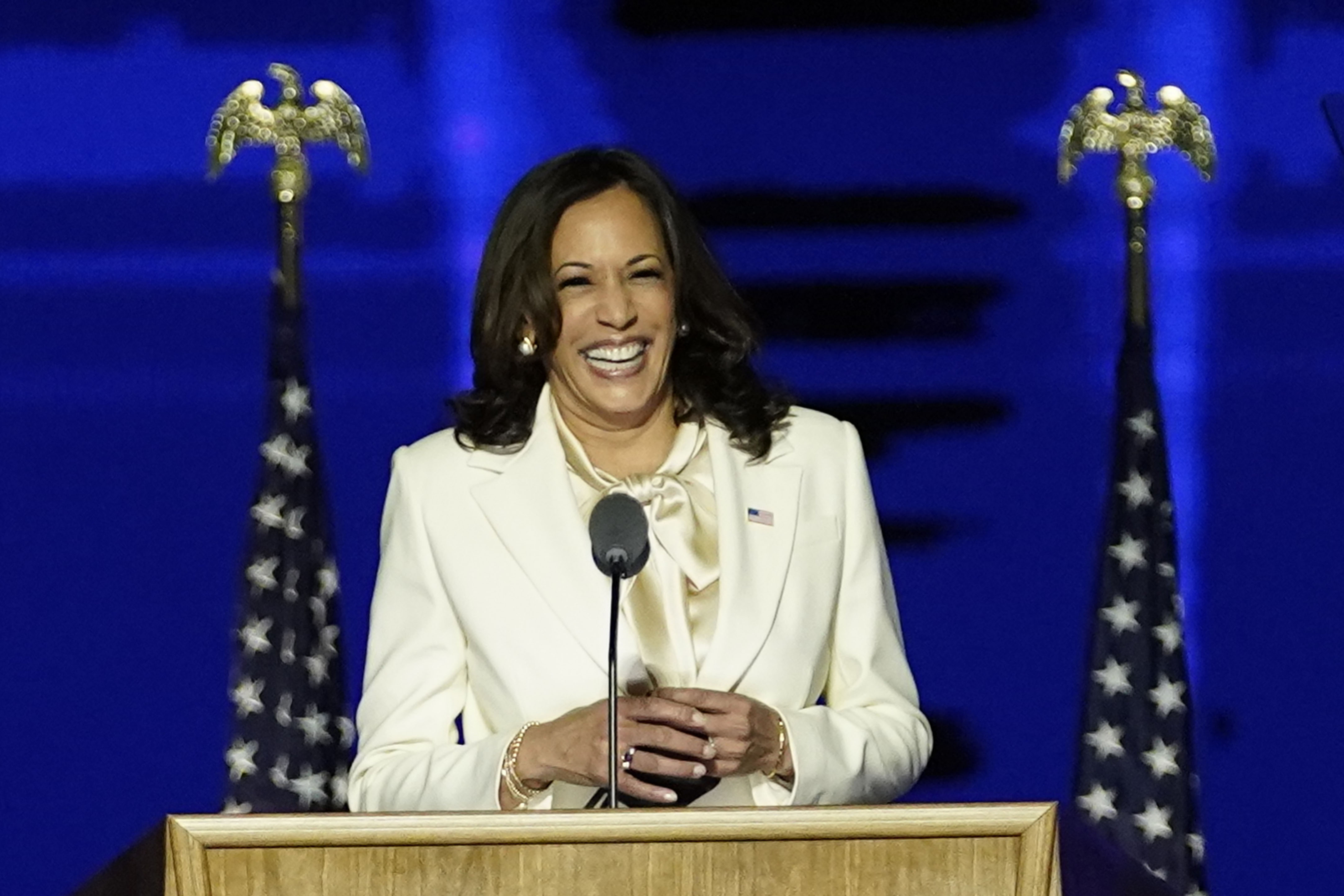 Kamala Harris smiles at a podium in the Chase Center.