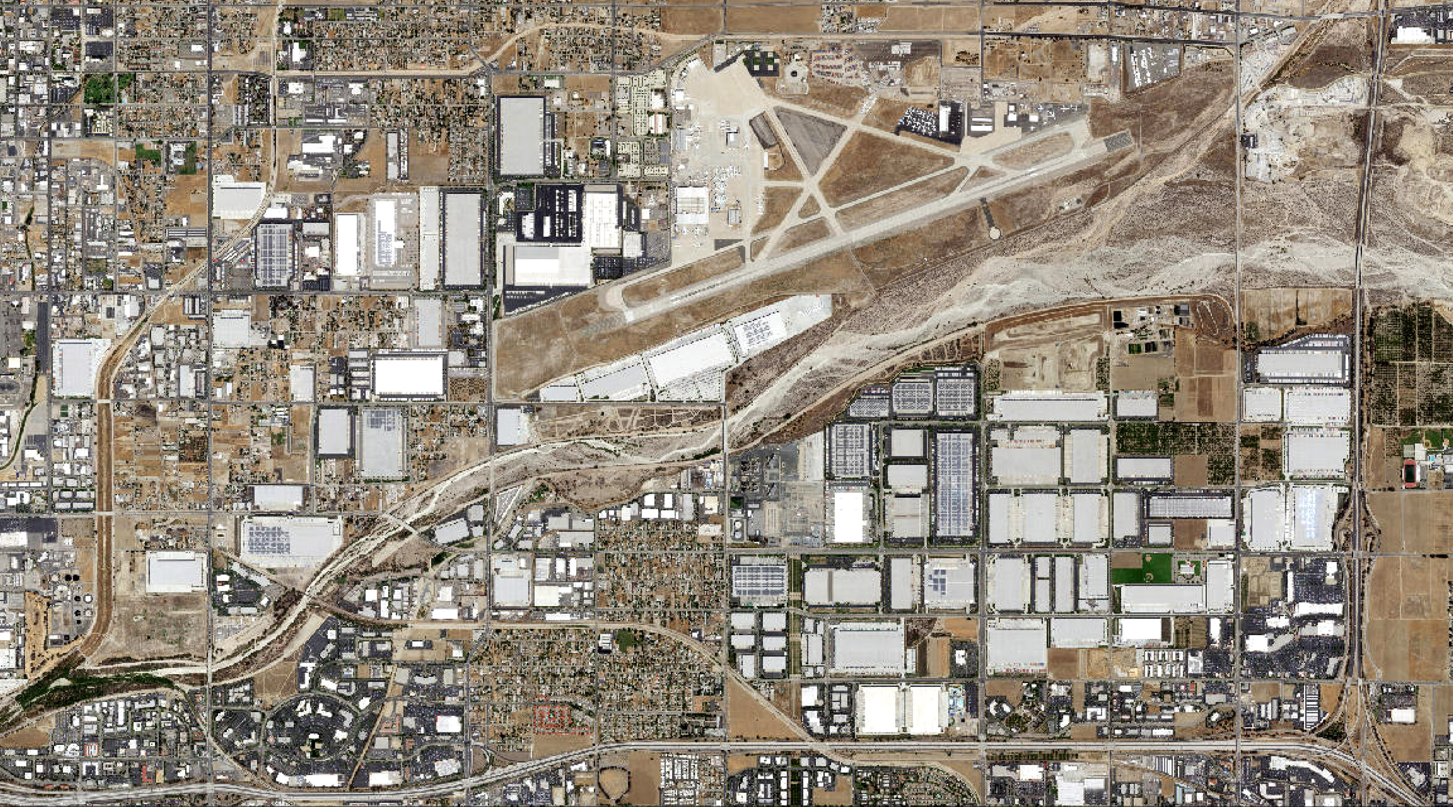 Satellite imagery shows the explosive growth of warehouses surrounding the San Bernardino International Airport between 2005 and 2018