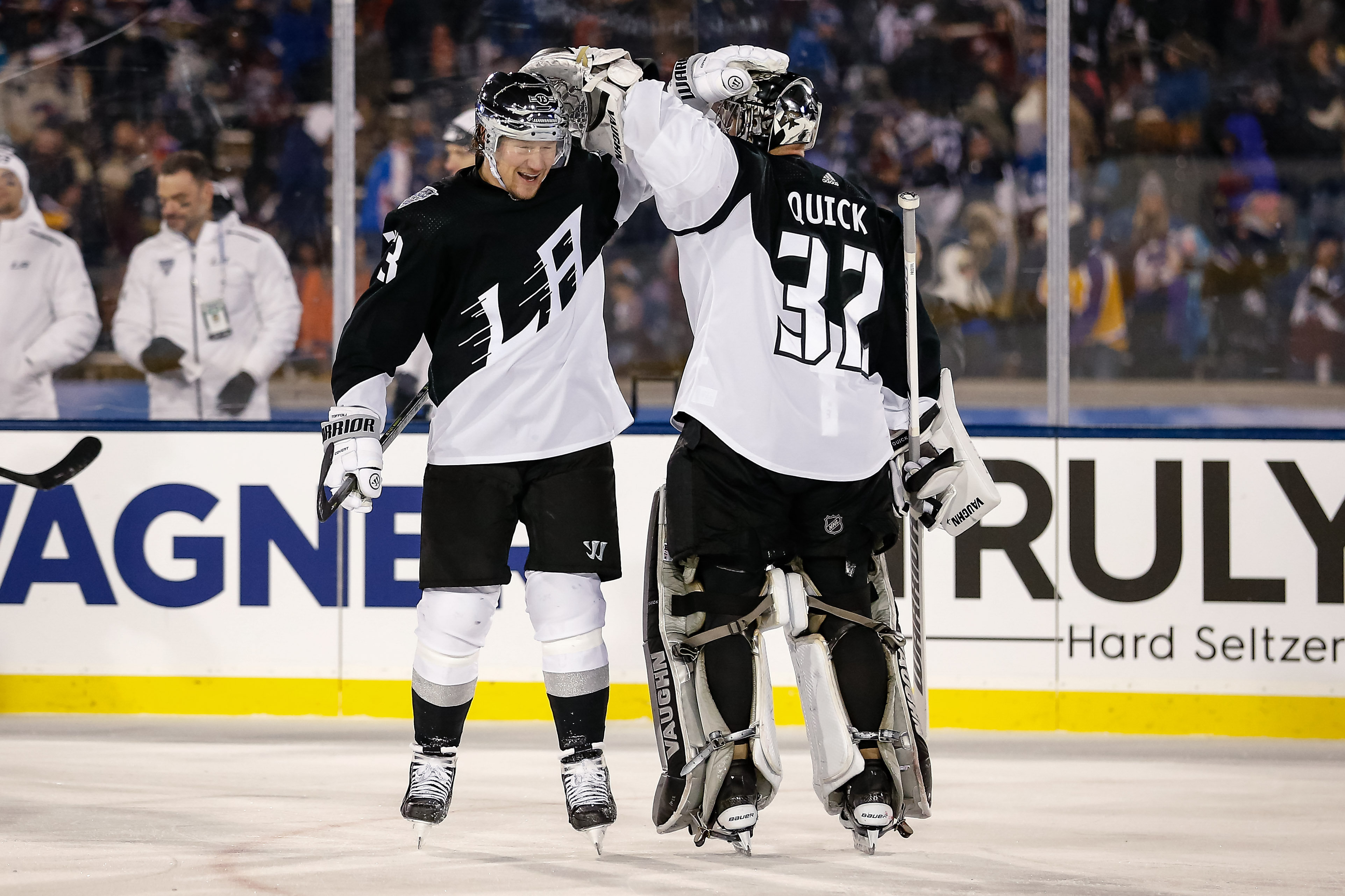 Los Angeles Kings right wing Tyler Toffoli (73) celebrates with goaltender Jonathan Quick (32) after scoring an empty net goal against the Colorado Avalanche in the third period during a Stadium Series hockey game at U.S. Air Force Academy Falcon Stadium.