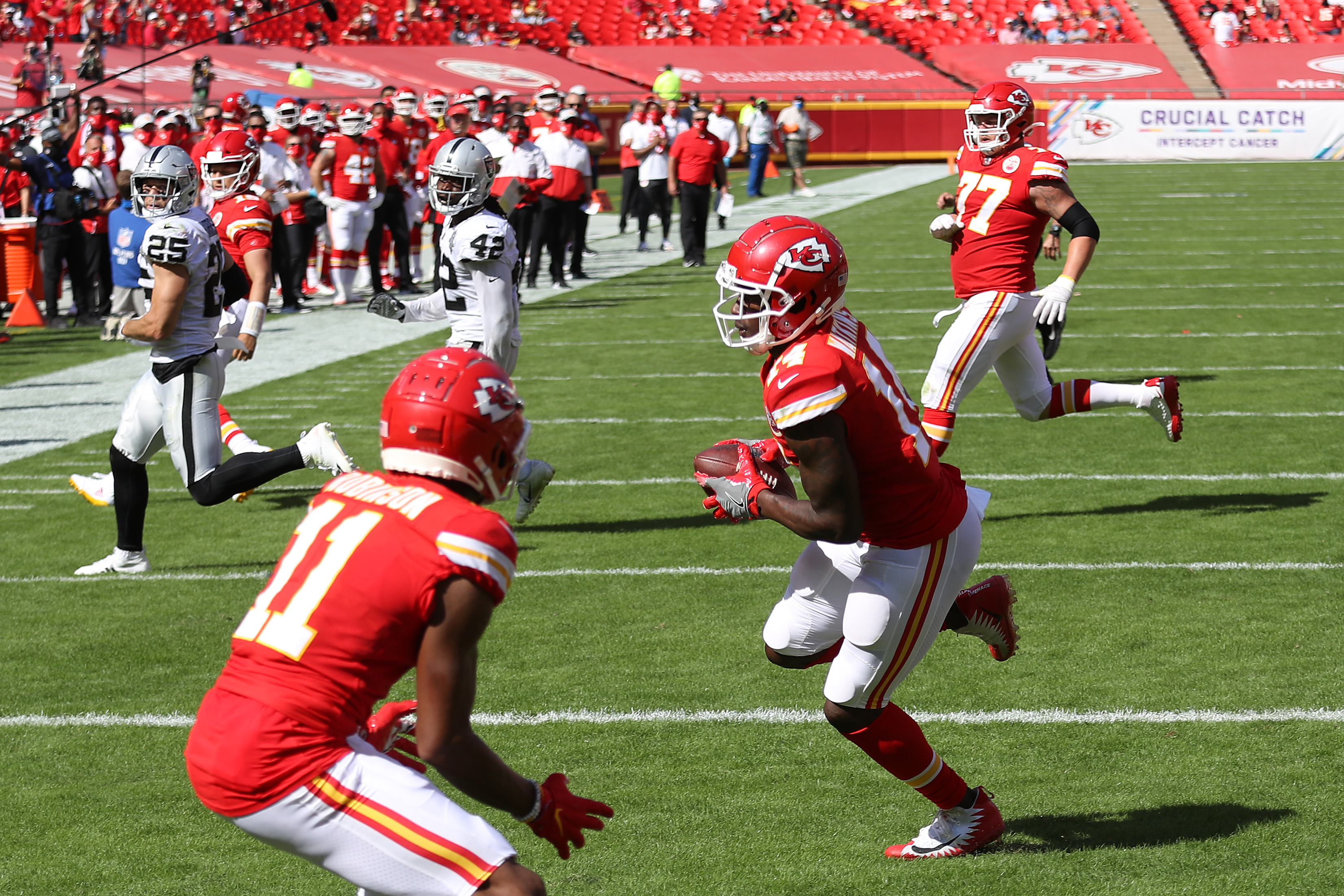 Sammy Watkins #14 of the Kansas City Chiefs scores a touchdown reception against the Las Vegas Raiders during the second quarter at Arrowhead Stadium on October 11, 2020 in Kansas City, Missouri.