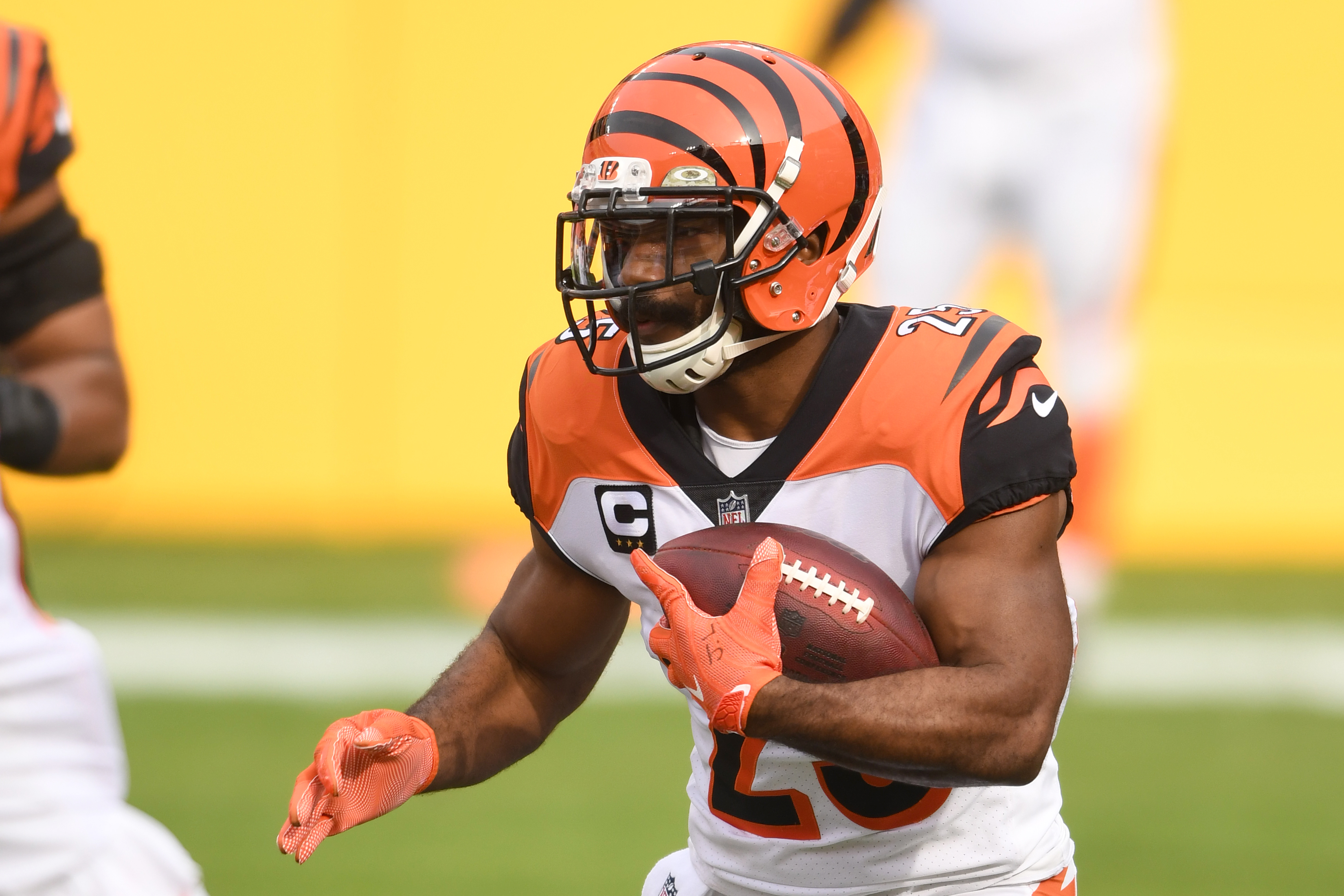 Giovani Bernard #25 of the Cincinnati Bengals runs with the ball a NFL football game against the Washington Football Team on November 22, 2020 at FedExField in Landover, Maryland.