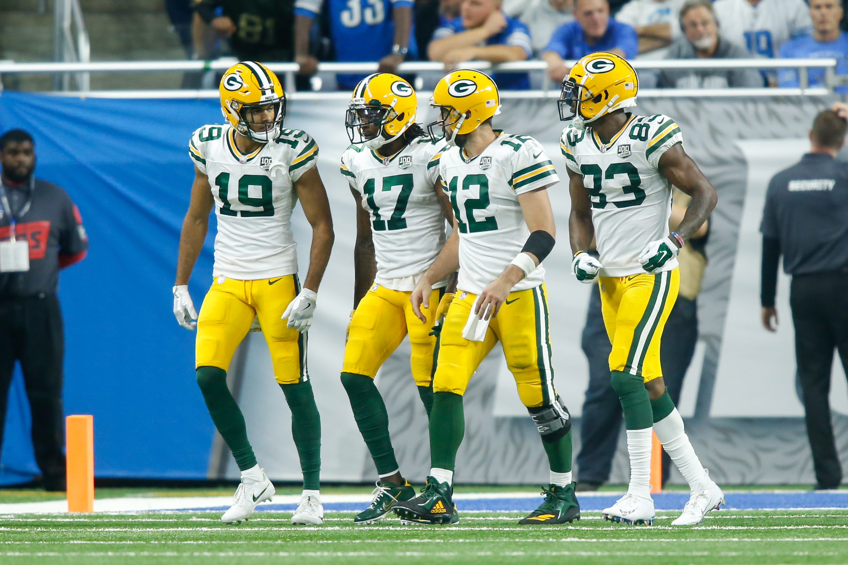 Green Bay Packers quarterback Aaron Rodgers walks to the sideline after a touchdown with Green Bay Packers wide receiver Equanimeous St. Brown, Green Bay Packers wide receiver Davante Adams, and Green Bay Packers wide receiver Marquez Valdes-Scantling during a regular season game between the Green Bay Packers and the Detroit Lions on October 7, 2018 at Ford Field in Detroit, Michigan.