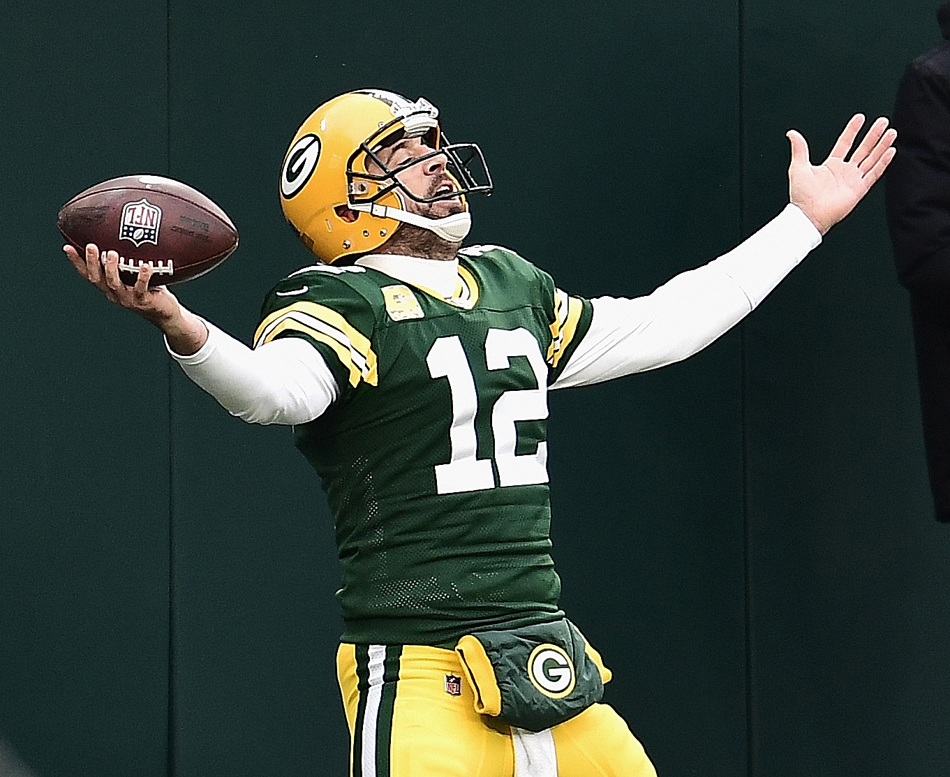 Aaron Rodgers #12 of the Green Bay Packers celebrates scoring his first running touchdown of the season in the 2nd quarter against the Jacksonville Jaguars at Lambeau Field on November 15, 2020 in Green Bay, Wisconsin.