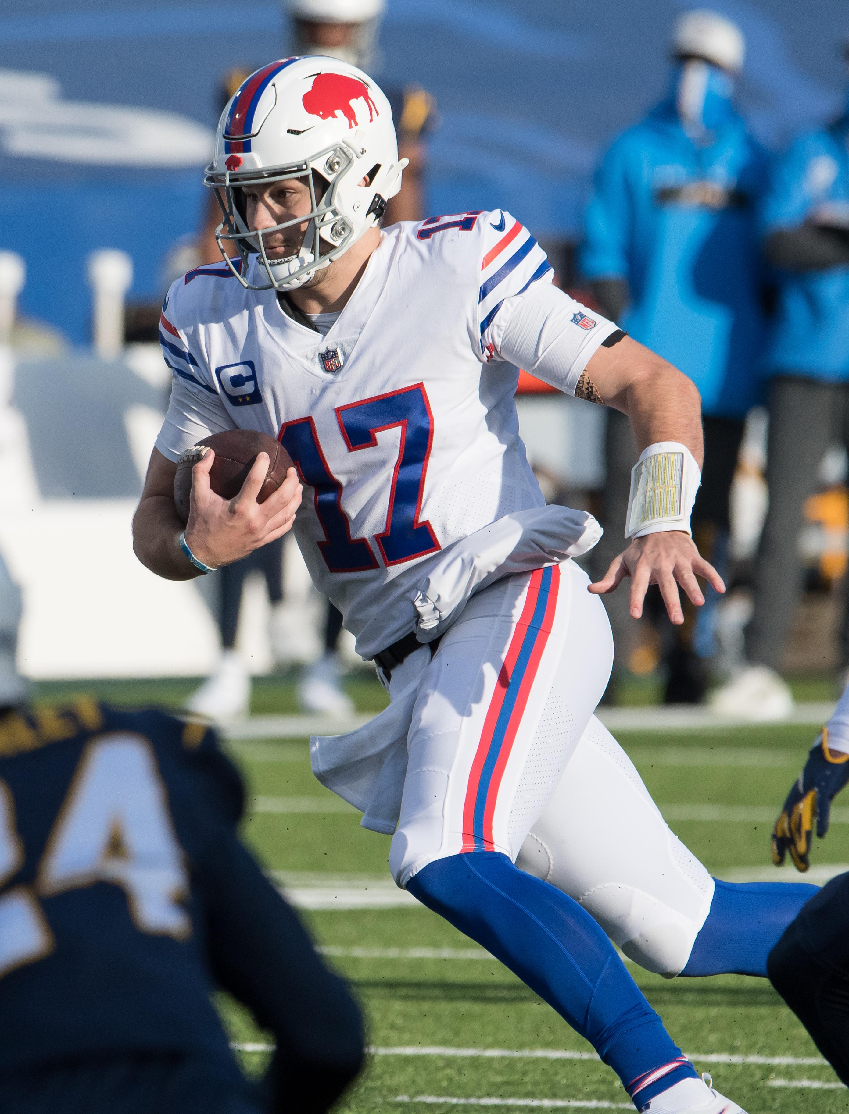 Buffalo Bills quarterback Josh Allen (17) runs for a first down in the second quarter at Bills Stadium.