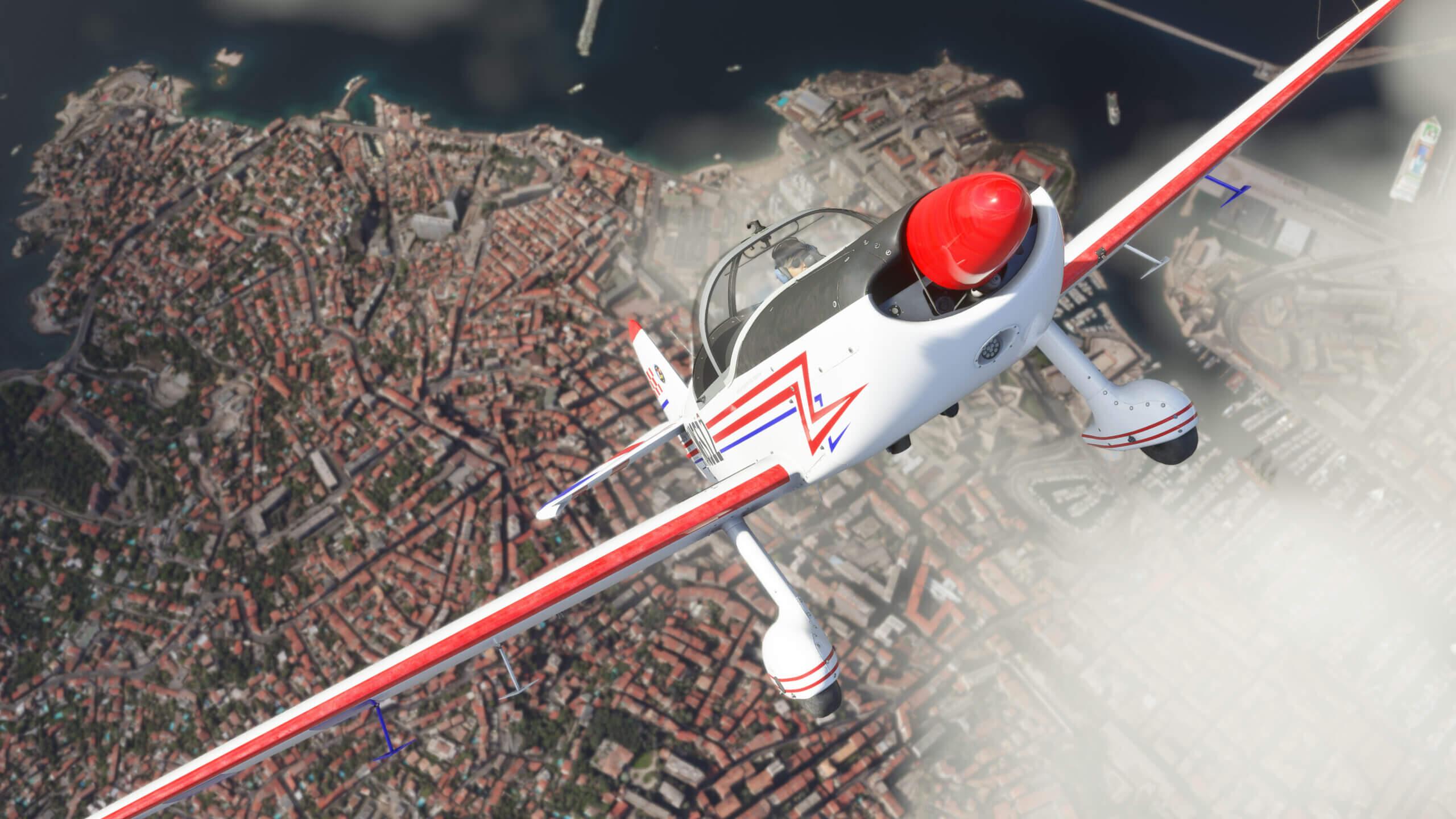 An aerobatic plane in a steep climb