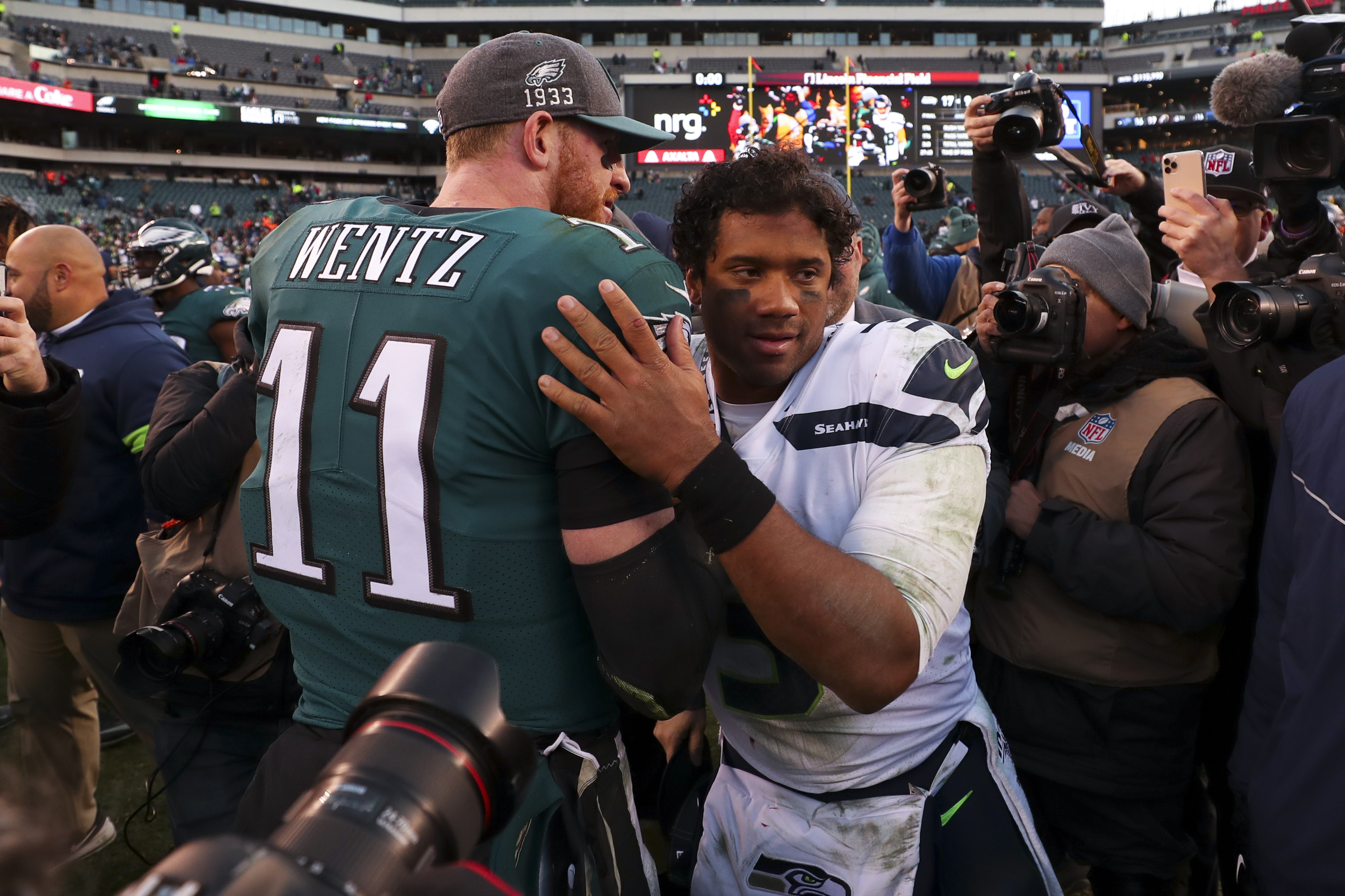 Russell Wilson #3 of the Seattle Seahawks hugs Carson Wentz #11 of the Philadelphia Eagles after the game at Lincoln Financial Field on November 24, 2019 in Philadelphia, Pennsylvania.