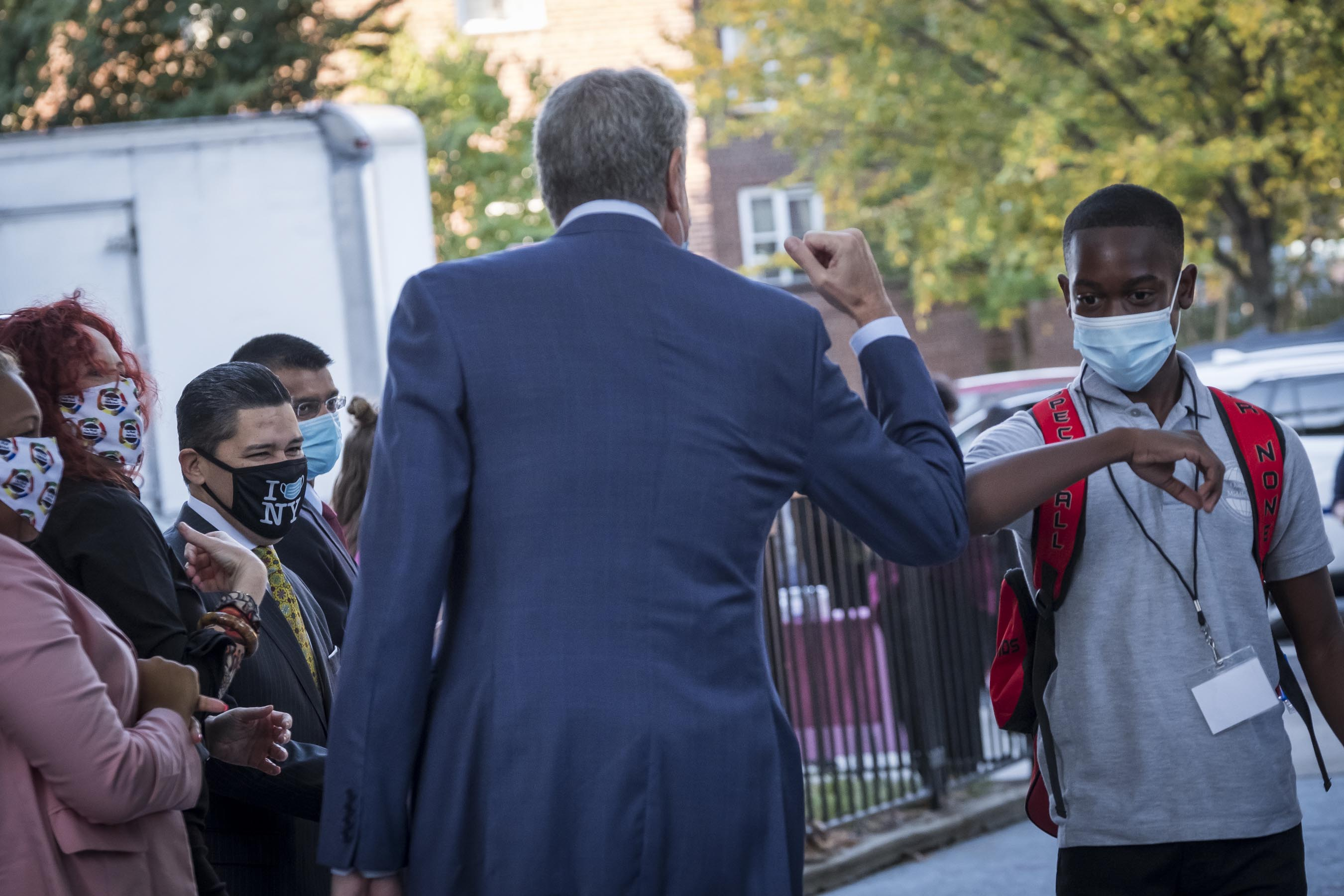 Mayor Bill de Blasio, Chancellor Richard Carranza and Department of Health and Mental Hygiene Commissioner Dave Chokshi welcome students back to One World Middle School at Edenwald in the Bronx on Oct. 1.