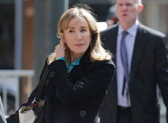 Actress Felicity Huffman, accused in the college admissions scandal, arrives at a Boston courthouse April 3.