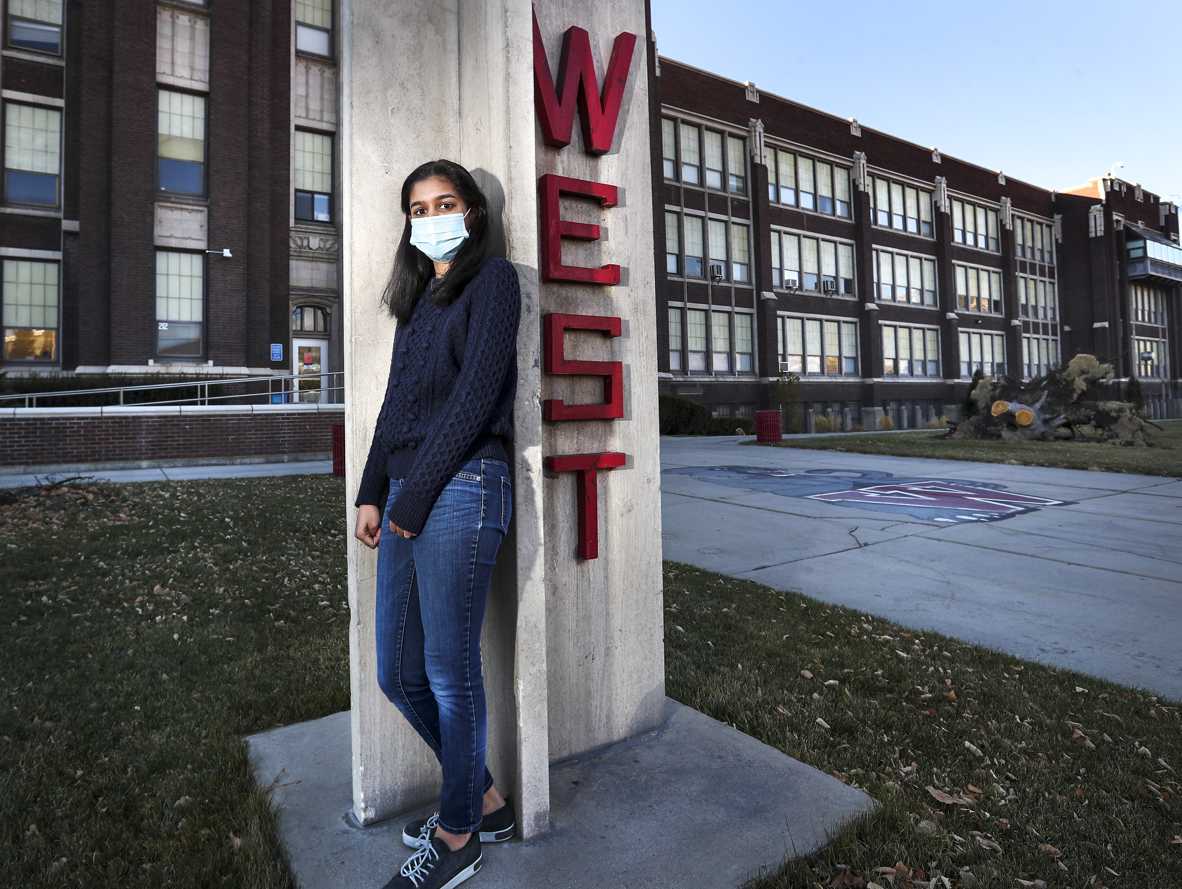 Arundhati Oommen, the nonvoting student member of the Salt Lake City Board of Education student member, poses for a portrait in front of West High School in Salt Lake City on Tuesday, Dec. 1, 2020. Oommen is urging the board to allow 16-year-olds to vote in school board elections because the board's actions impact them significantly.