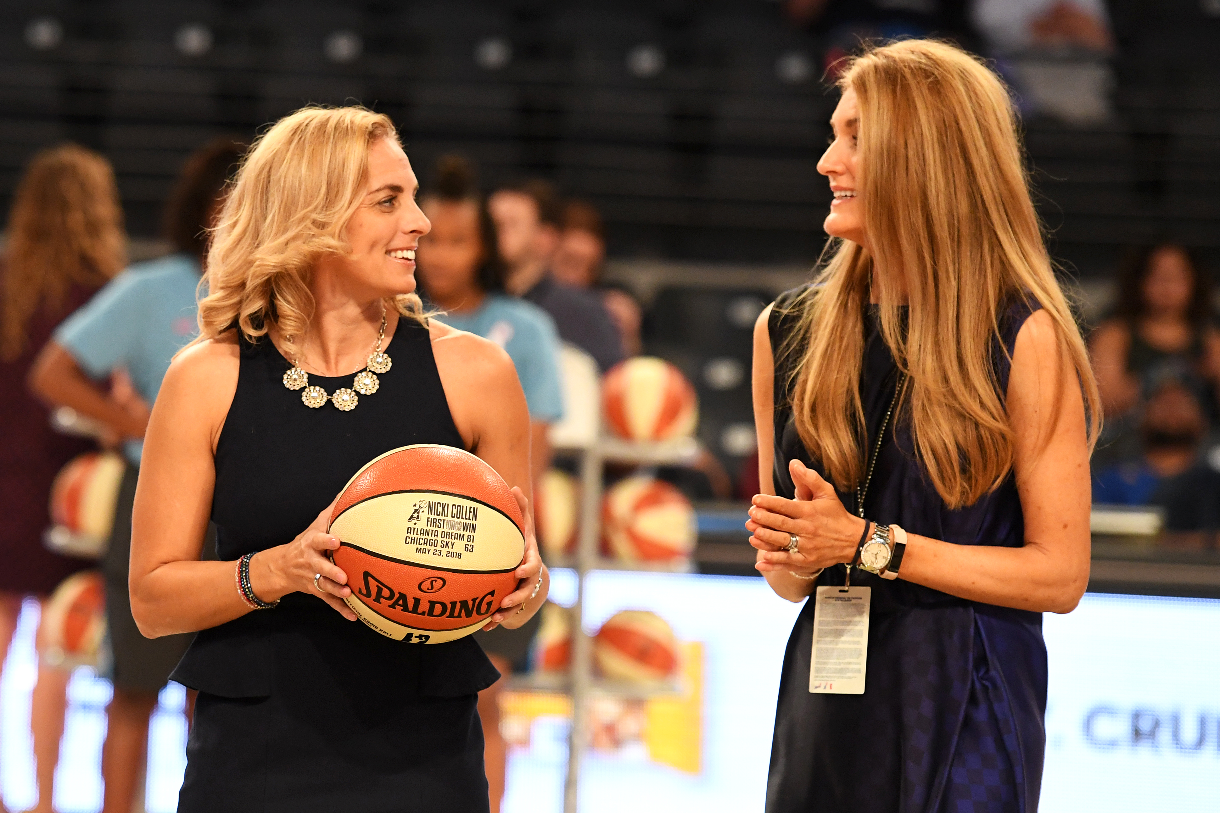 Head Coach Nicki Collen and Kelly Loefller, Co-owner of the Atlanta Dream stand on the court in the McCamish Pavilion in Atlanta, Georgia prior to tip-off in the Minnesota Lynx vs. Atlanta Dream game on May 29, 2018.