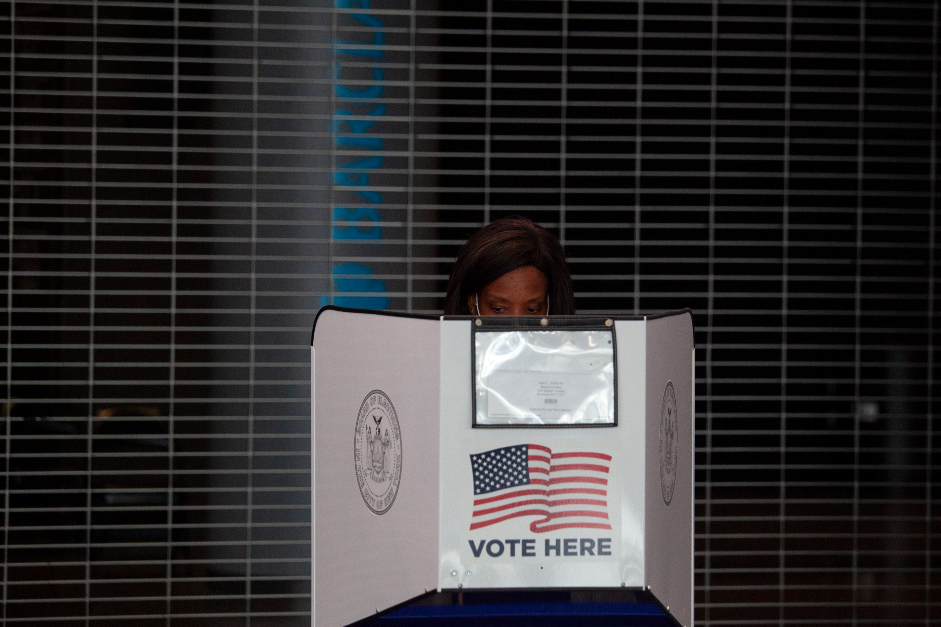 A Brooklyn resident votes at the Barclays Center Saturday morning, Oct. 24, 2020.