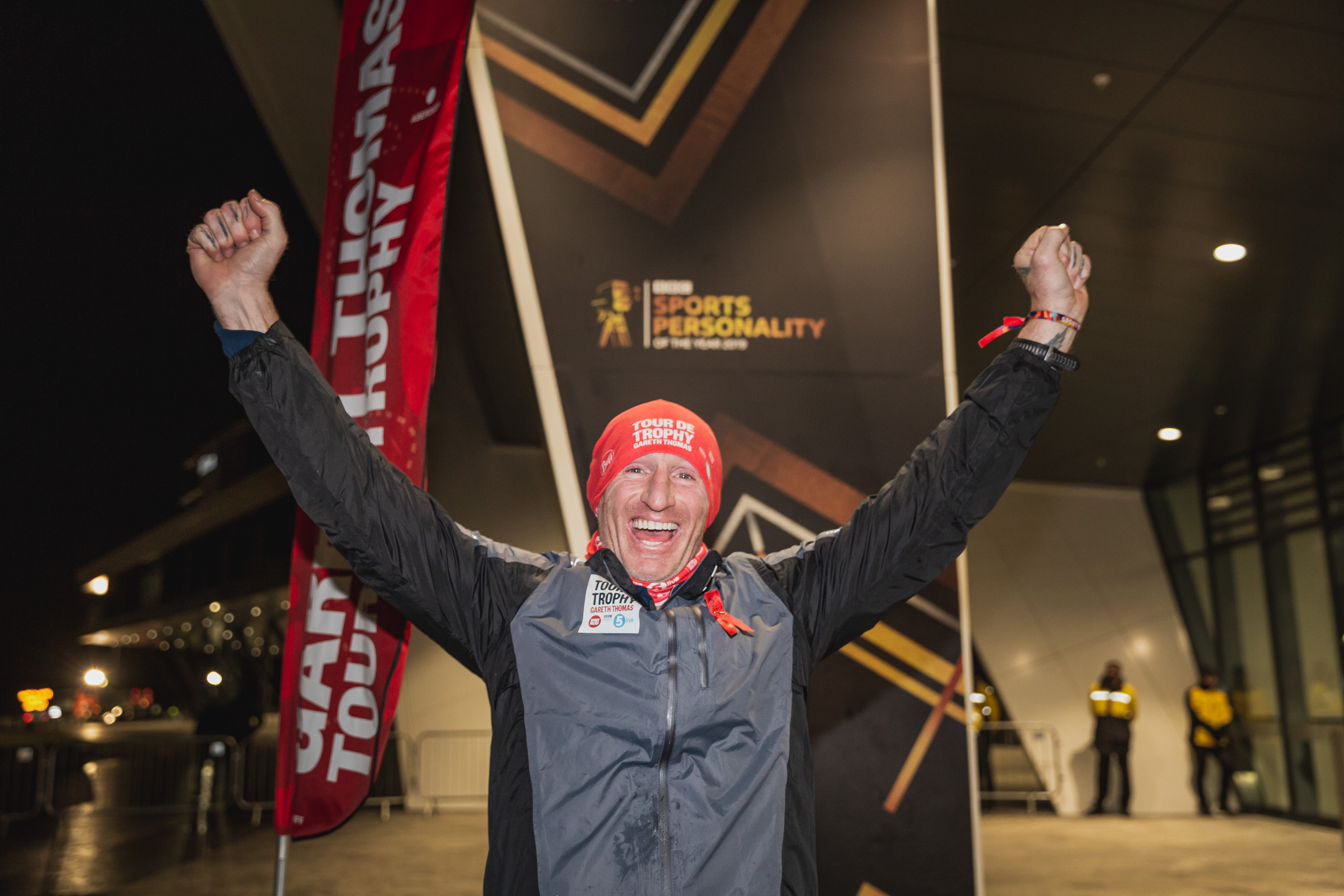 Gareth Thomas lifts his hands in the air after he completes Day 7 of the Tour De Trophy challenge.