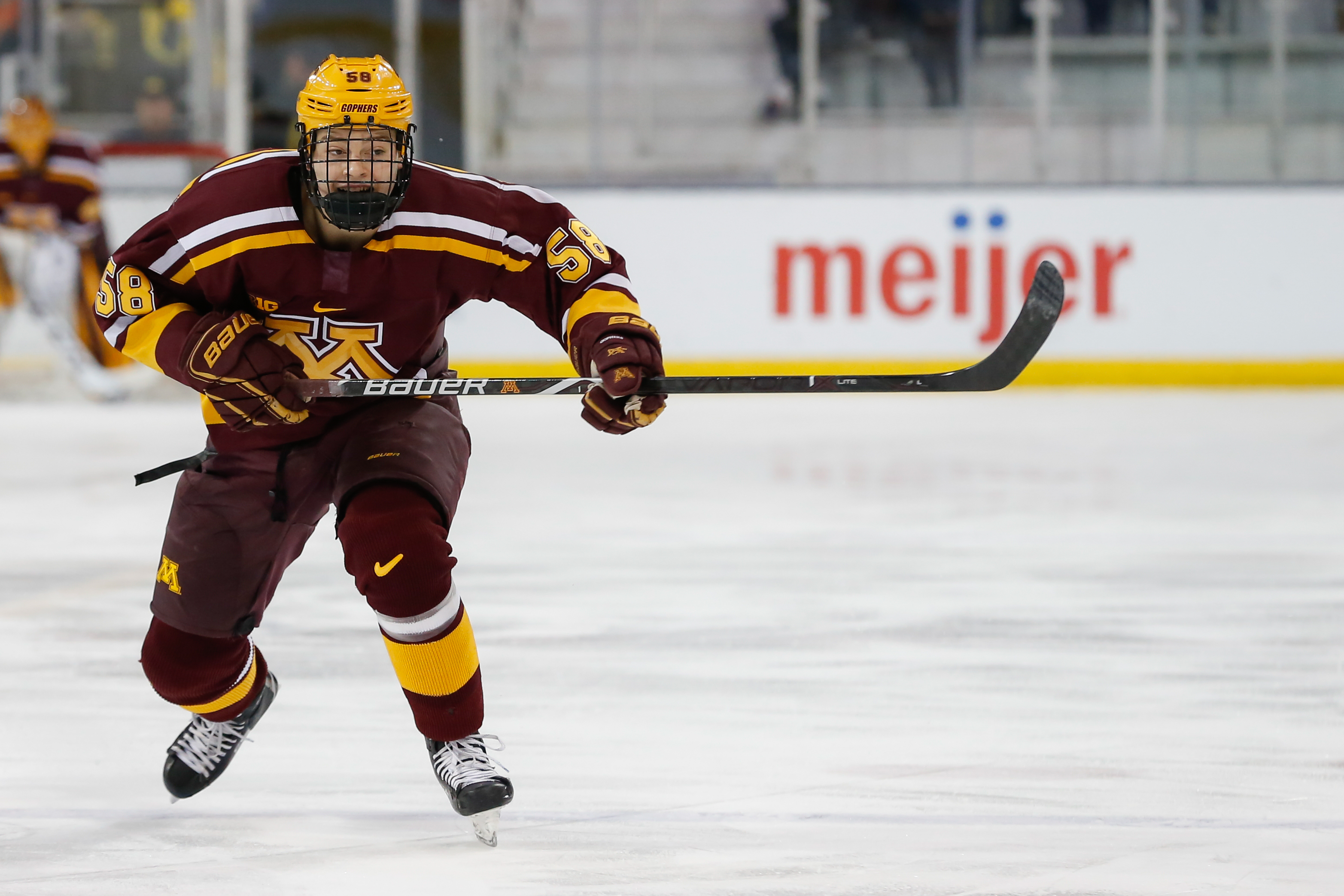 Minnesota Golden Gophers forward Sampo Ranta (58) chases after the puck during a regular season Big 10 Conference hockey game between the Minnesota Golden Gophers and Michigan Wolverines on December 8, 2018 at Yost Ice Arena in Ann Arbor, Michigan.