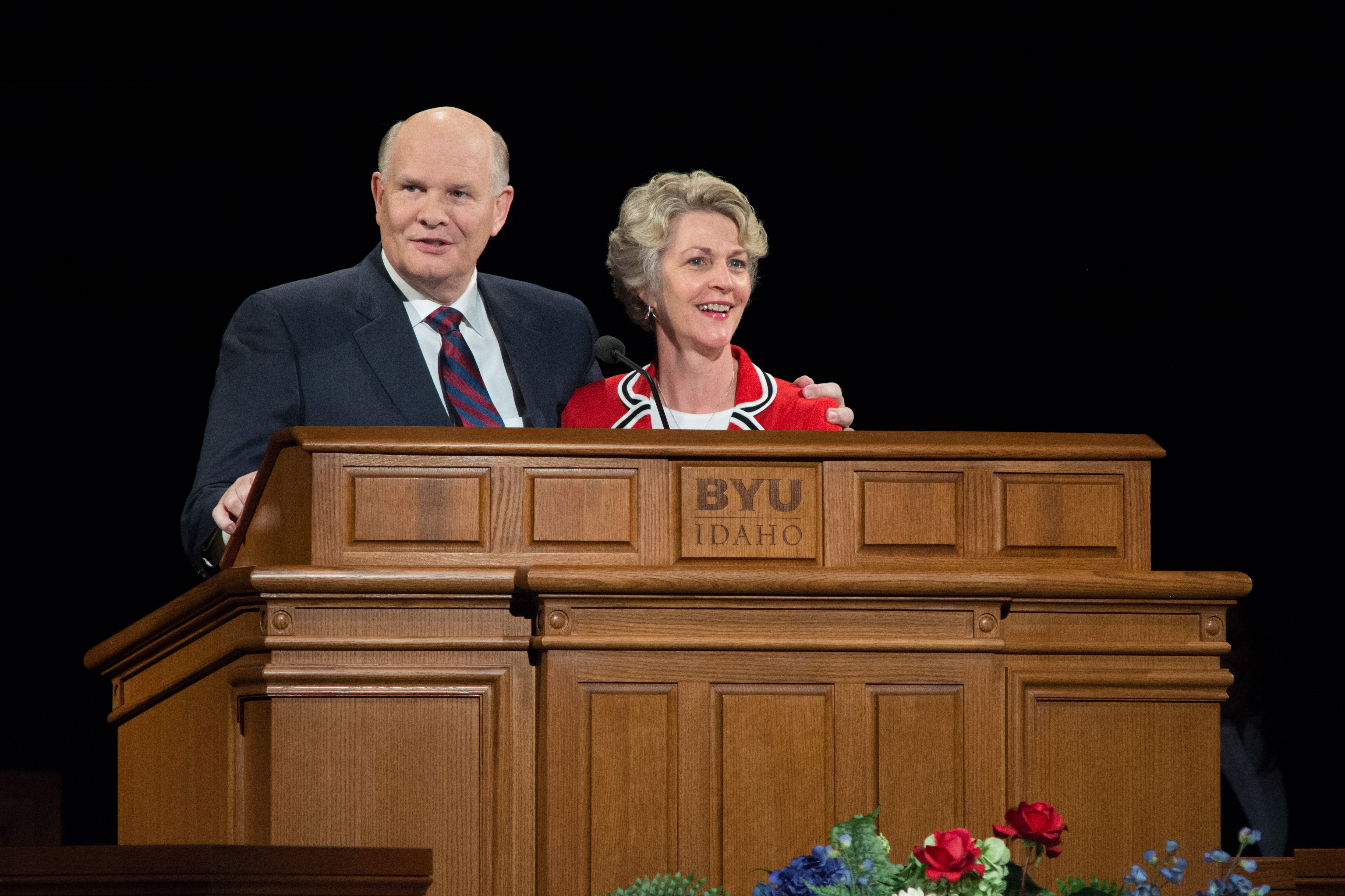 Elder Dale G. Renlund of the Quorum of the Twelve Apostles and his wife, Sister Ruth L. Renlund, stand together and speak at a BYU-Idaho campus devotional on Sept. 26, 2017.