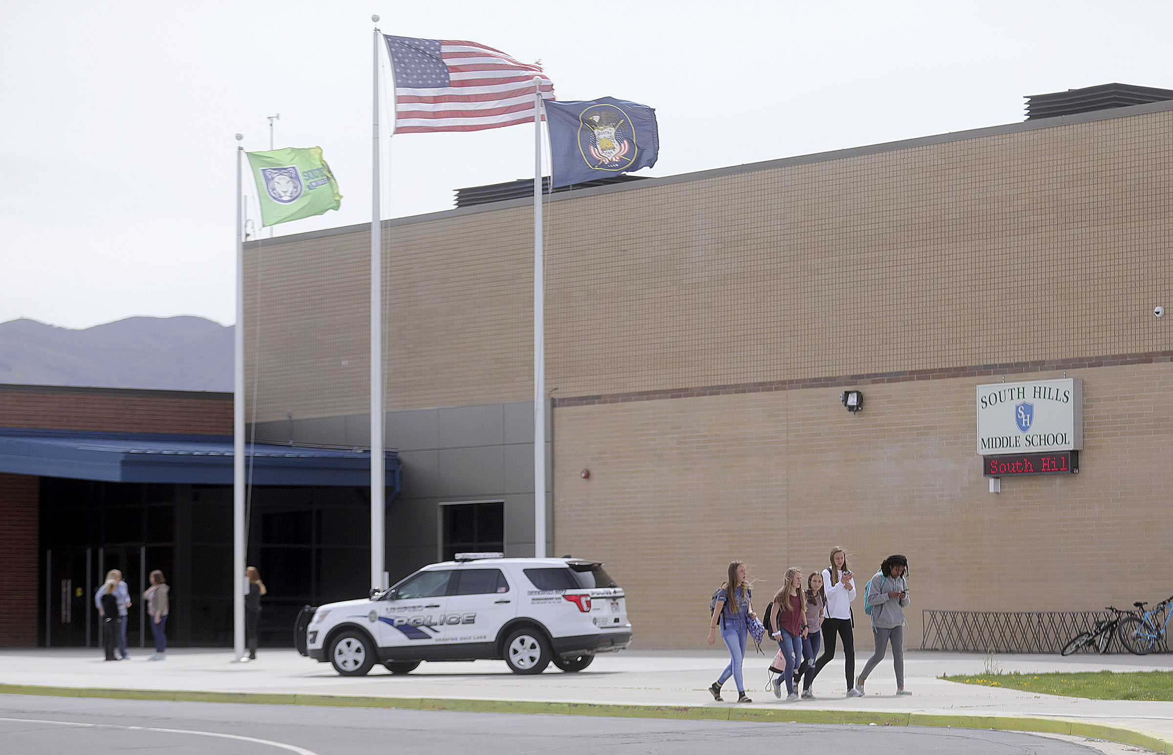 Students leave South Hills Middle School at the end of the day, after a man attacked a school resource officer and injured him with a piece of wood in Riverton on Monday, April 29, 2019.