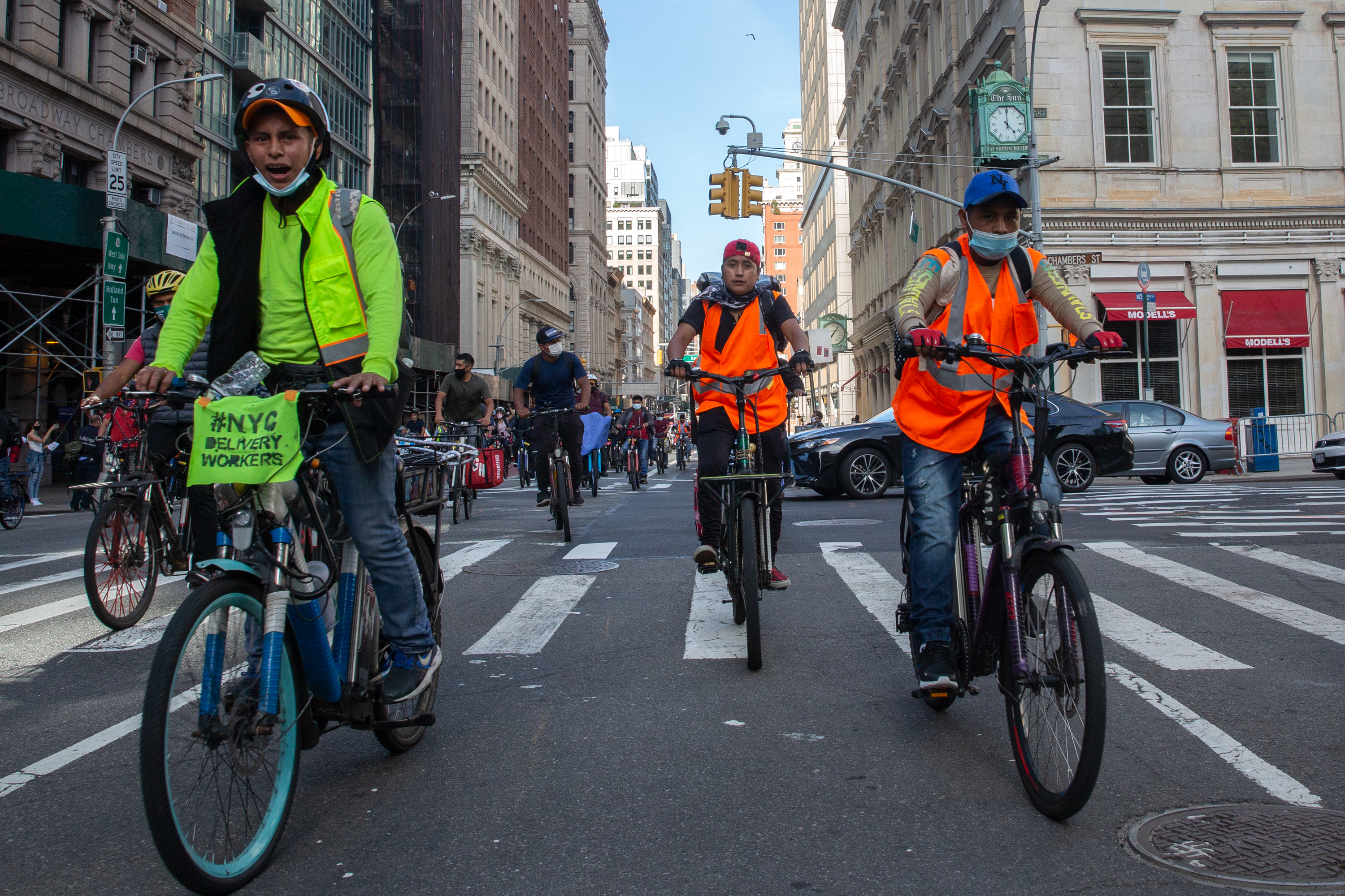 Delivery cyclists ride down Broadway in Manhattan to protest a lack of protection during the coronavirus pandemic, Oct. 15, 2020.