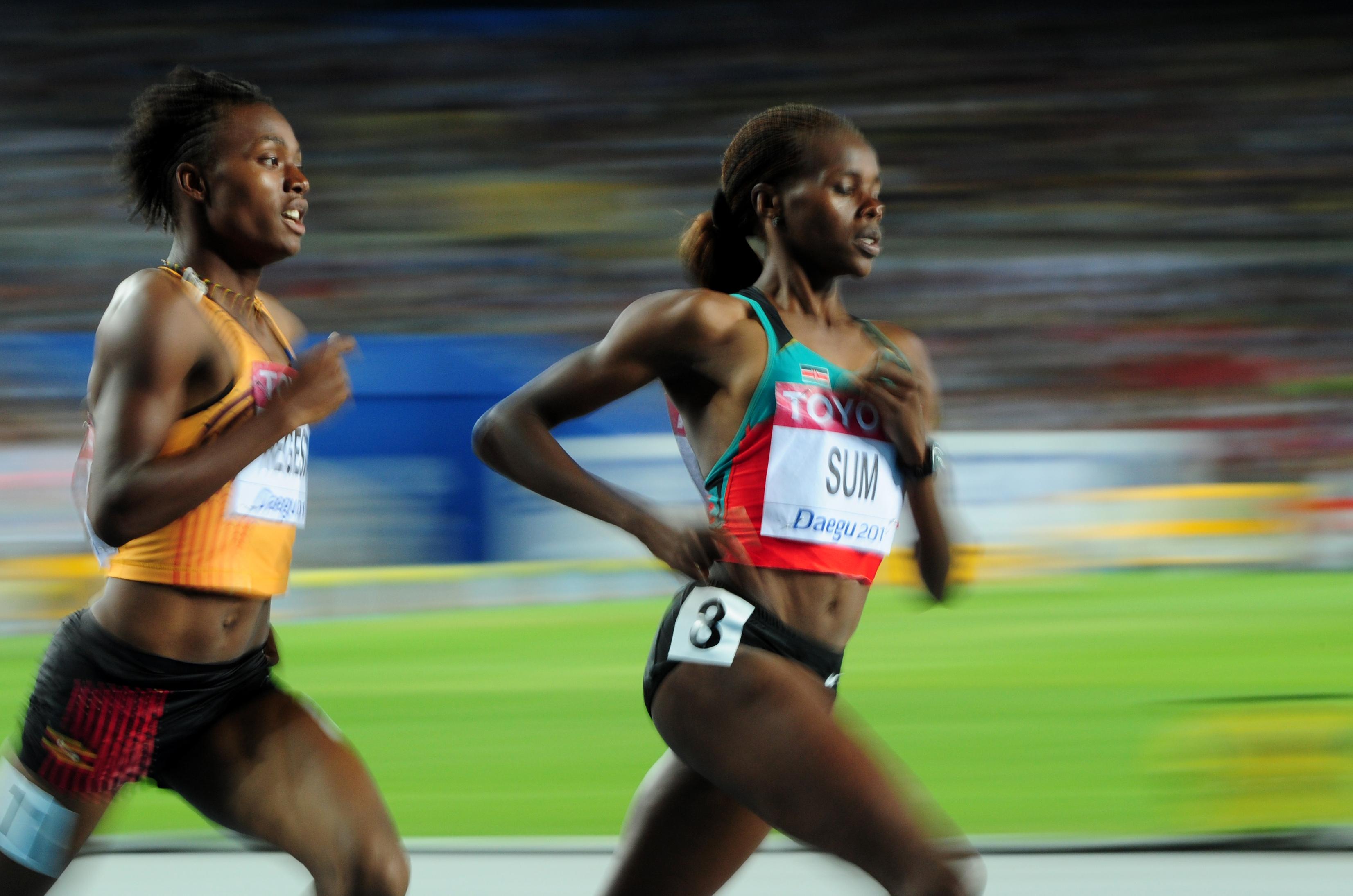 (L/R) Uganda's Annet Negesa and Kenya's
