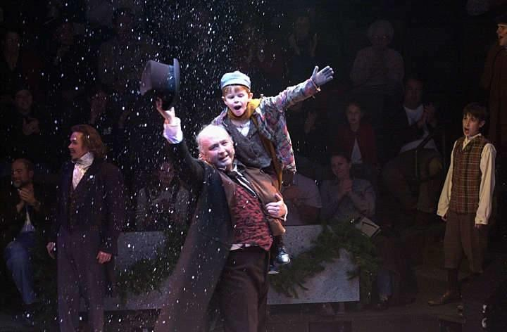 """Richard Wilkins as Scrooge and Scott Fidel as Tiny Tim in Hale Centre Theatre's 2002 production of """"A Christmas Carol."""""""