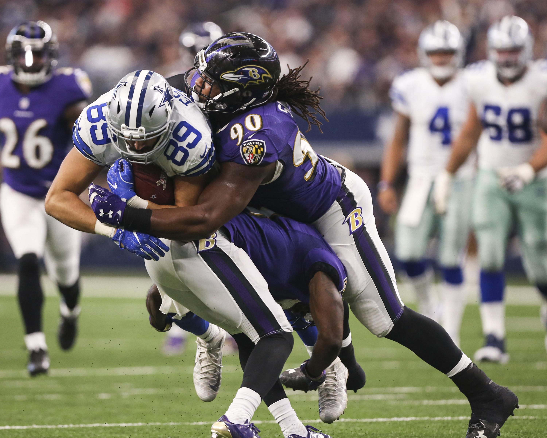 Cowboys turn away Ravens, stretch winning streak to 9