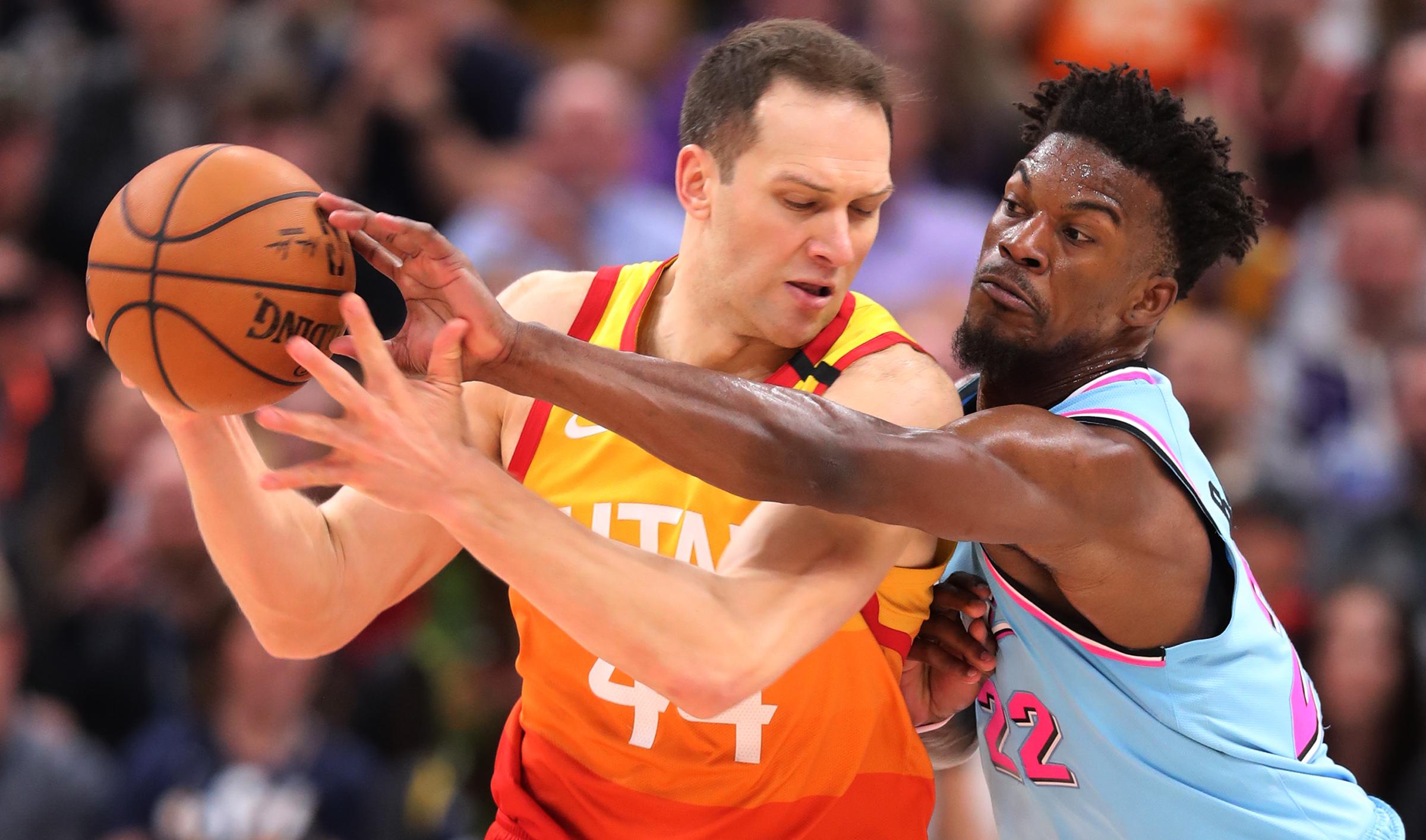 Utah Jazz forward Bojan Bogdanovic (44) works to keep Miami Heat forward Jimmy Butler (22) away from the ball as the Utah Jazz and the Miami Heat play in an NBA basketball game at Vivint Smart Home Arena in Salt Lake City on Wednesday, Feb. 12, 2020. Utah won 116-101.