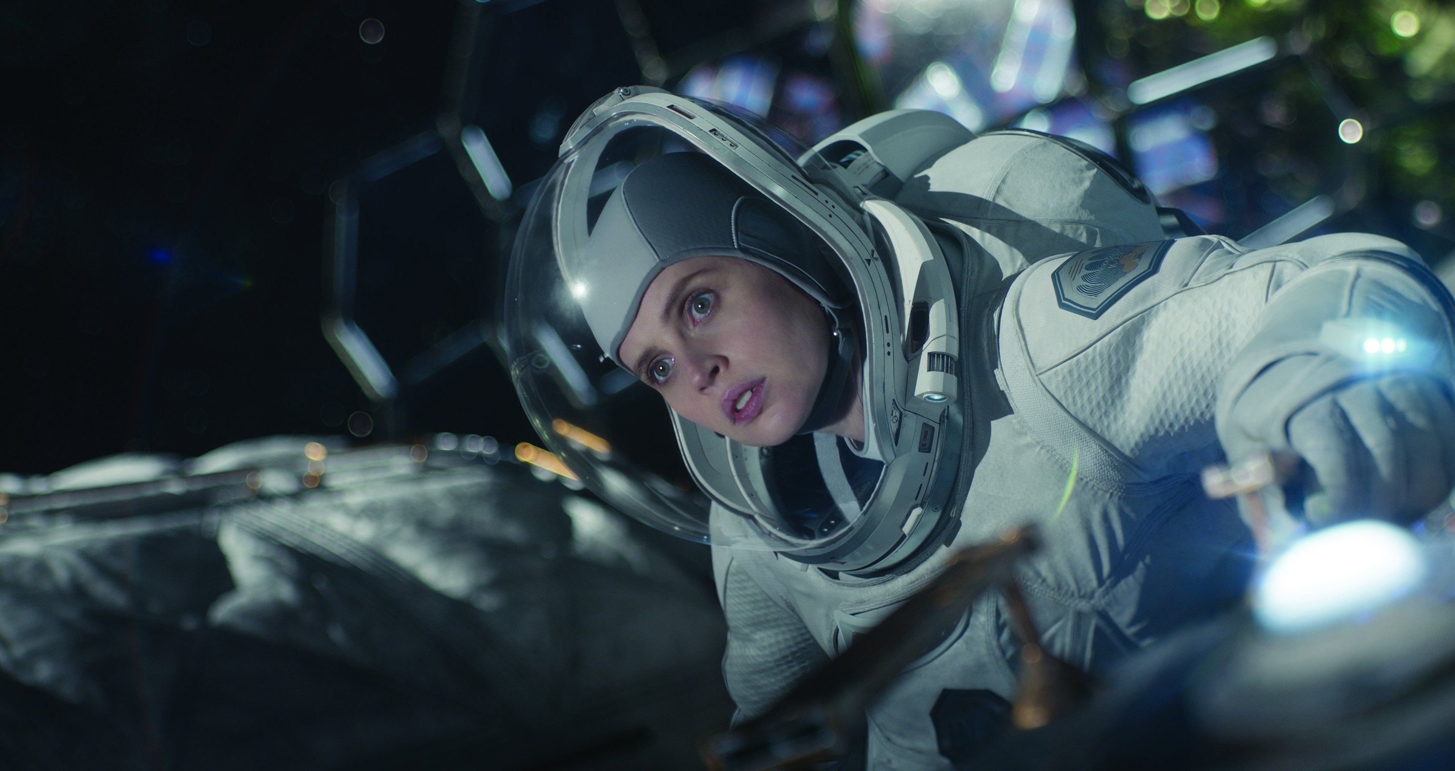 Felicity Jones as a space crew member floating around her ship in The Midnight Sky