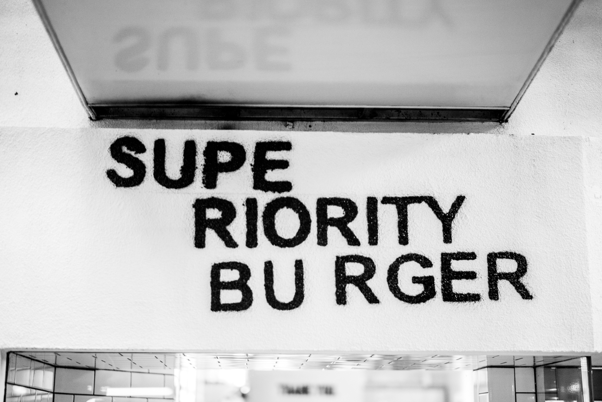 The exterior of superiority burger which shows the sign