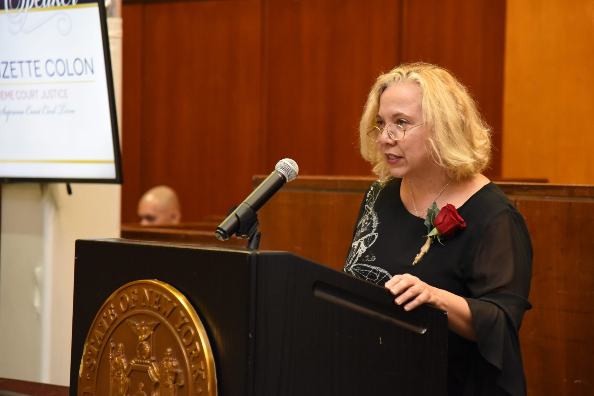 Judge Lizette Colon speaks at a Latino Court Officers Society awards celebration in 2019.