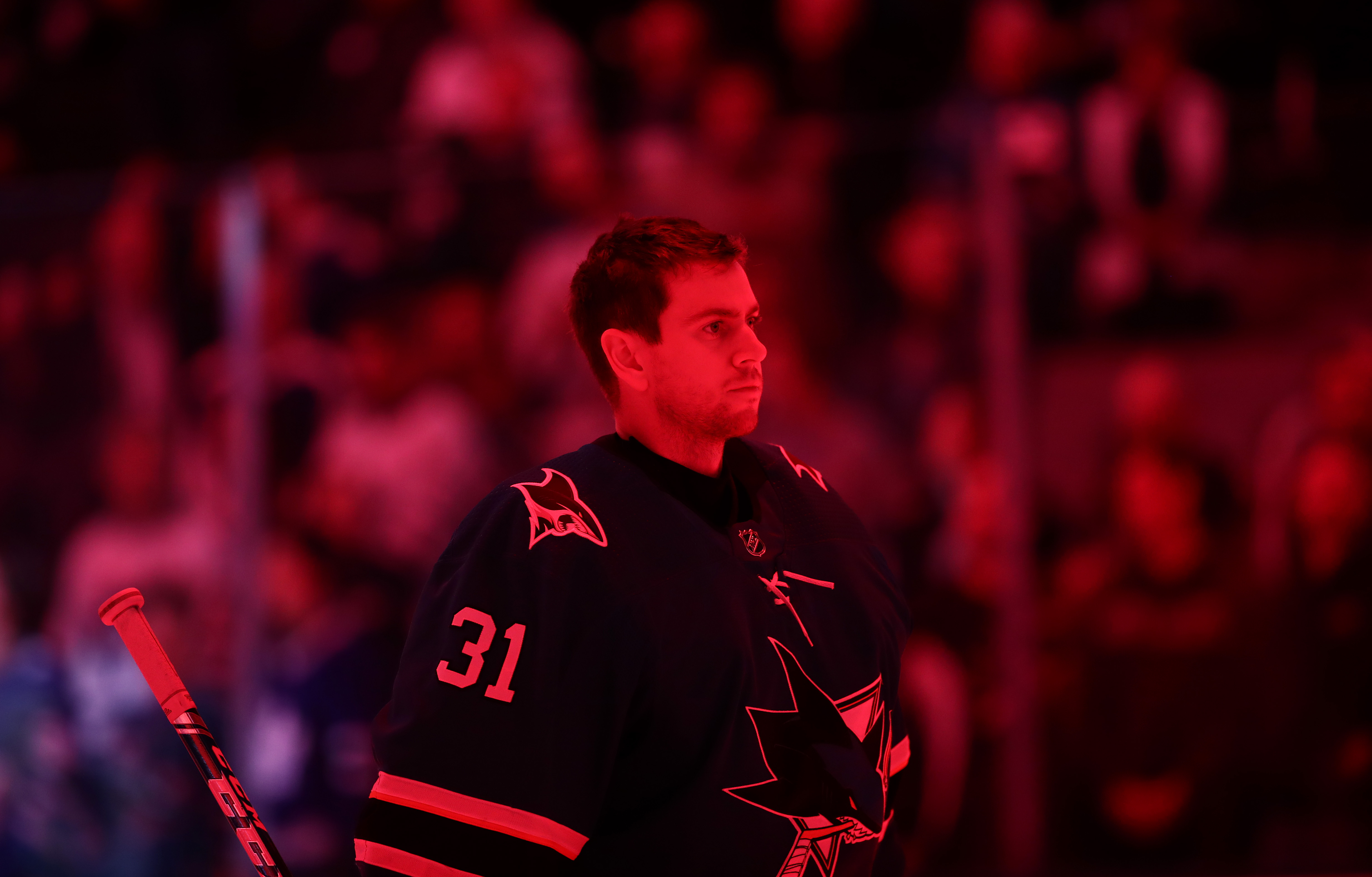 Martin Jones #31 of the San Jose Sharks stands for the National Anthem before their game against the Toronto Maple Leafs at SAP Center on March 03, 2020 in San Jose, California.