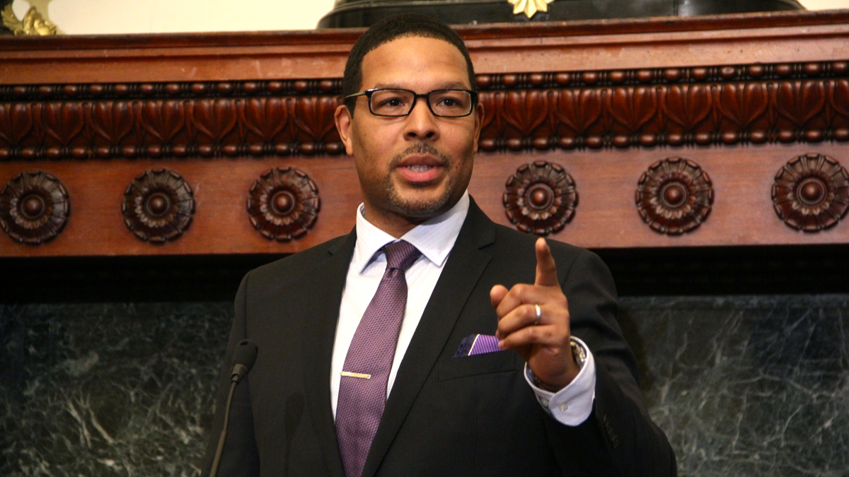 Otis Hackney pointing his finger while giving a speech at a press conference.
