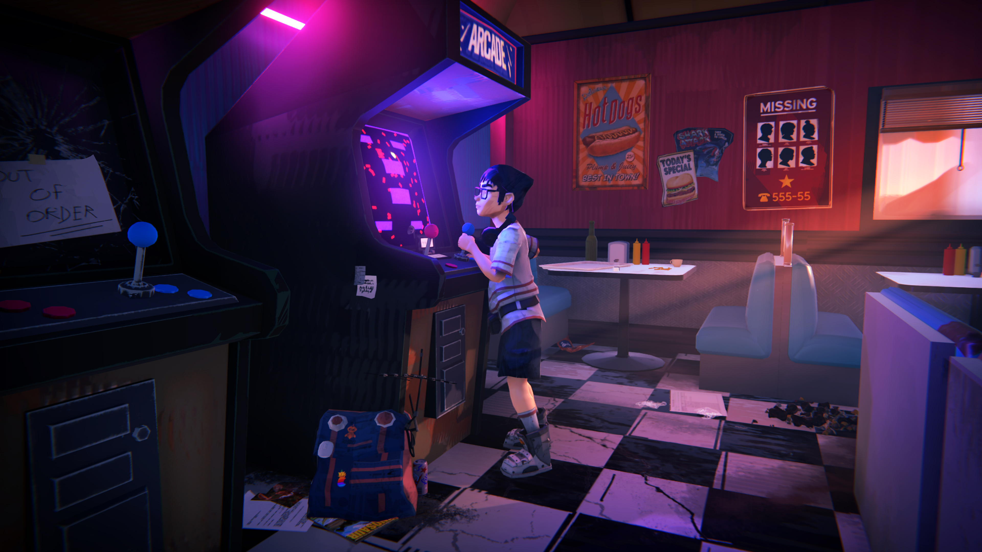 A young boy plays an arcade game in a dimly lit diner.