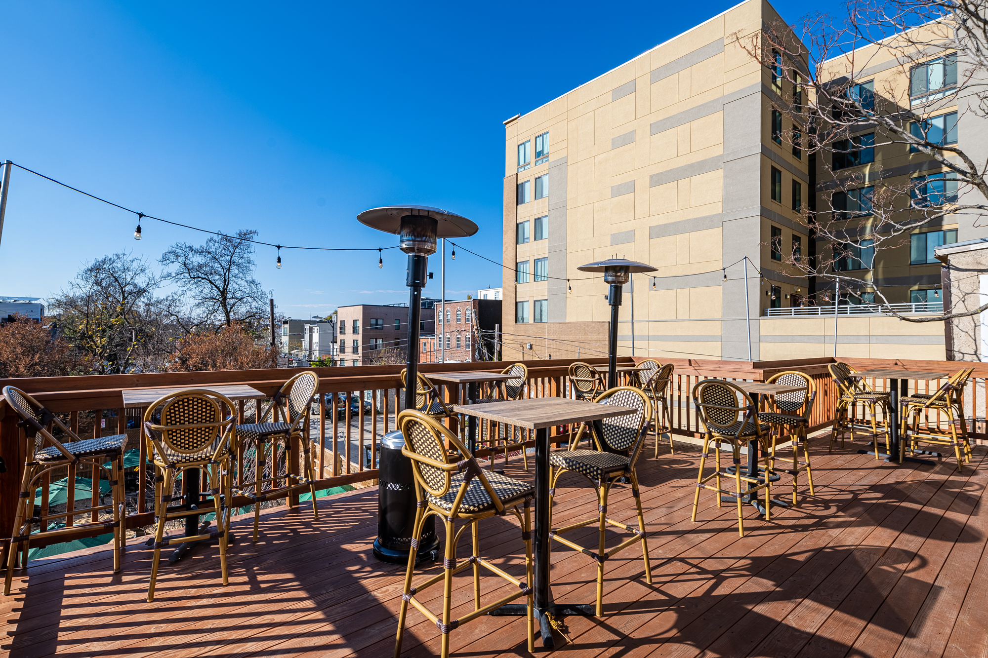 A second-level patio at St. Vincent wine in Park View