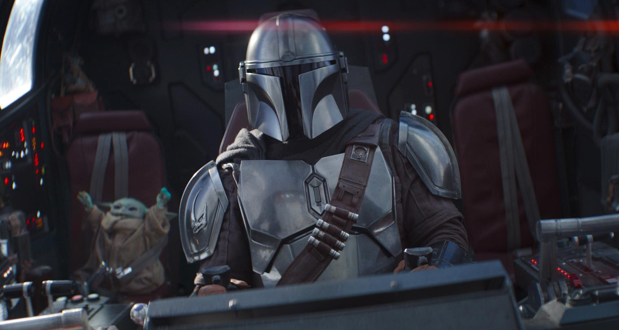 The Child and the Mandalorian (Pedro Pascal) in Lucasfilm's THE MANDALORIAN