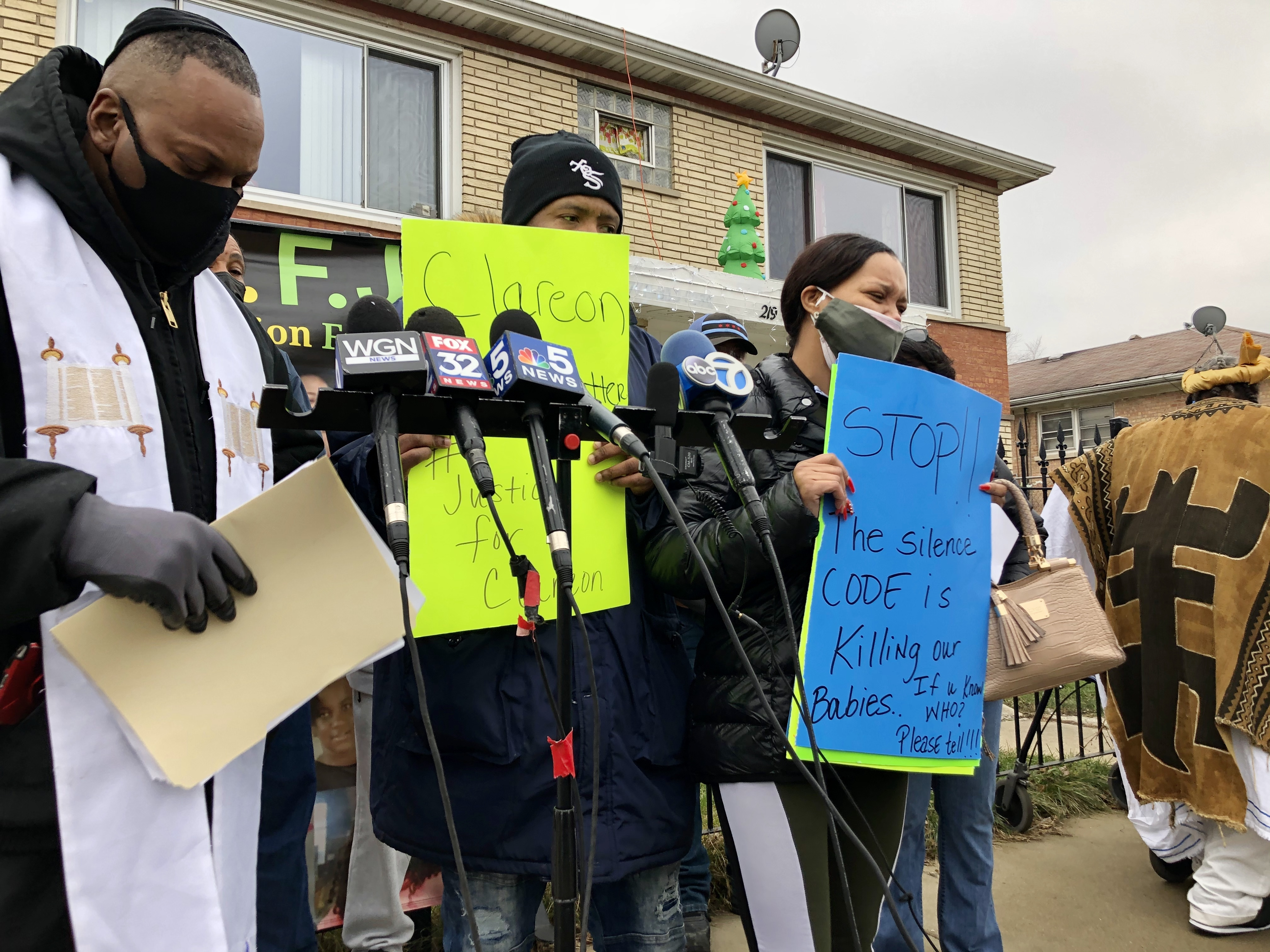 The parents of 5-year-old Clareon Williams speak to reporters in the 200 block of West 115th Street Friday, where the boy was shot in the head Nov. 16.